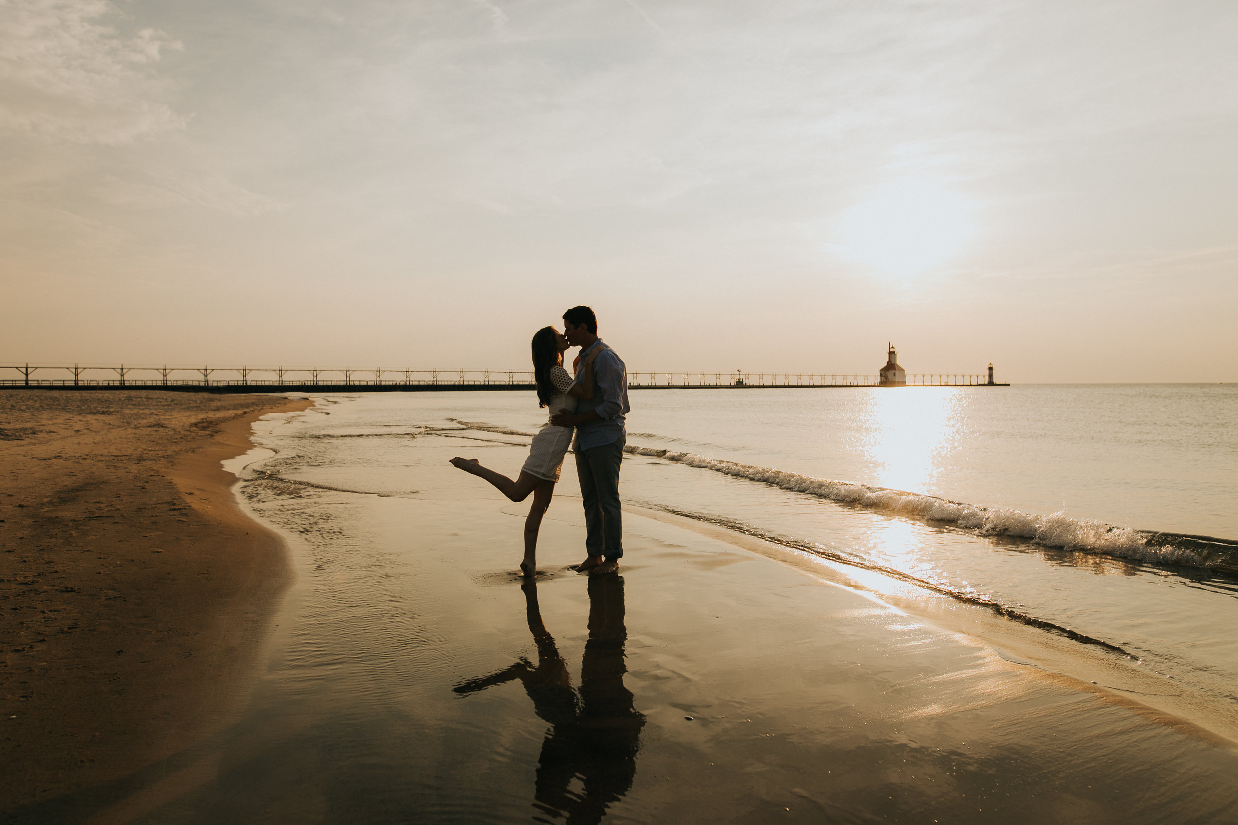 St. Joe, MI engagement pictures, beach, lighthouse, silhouette, sunset