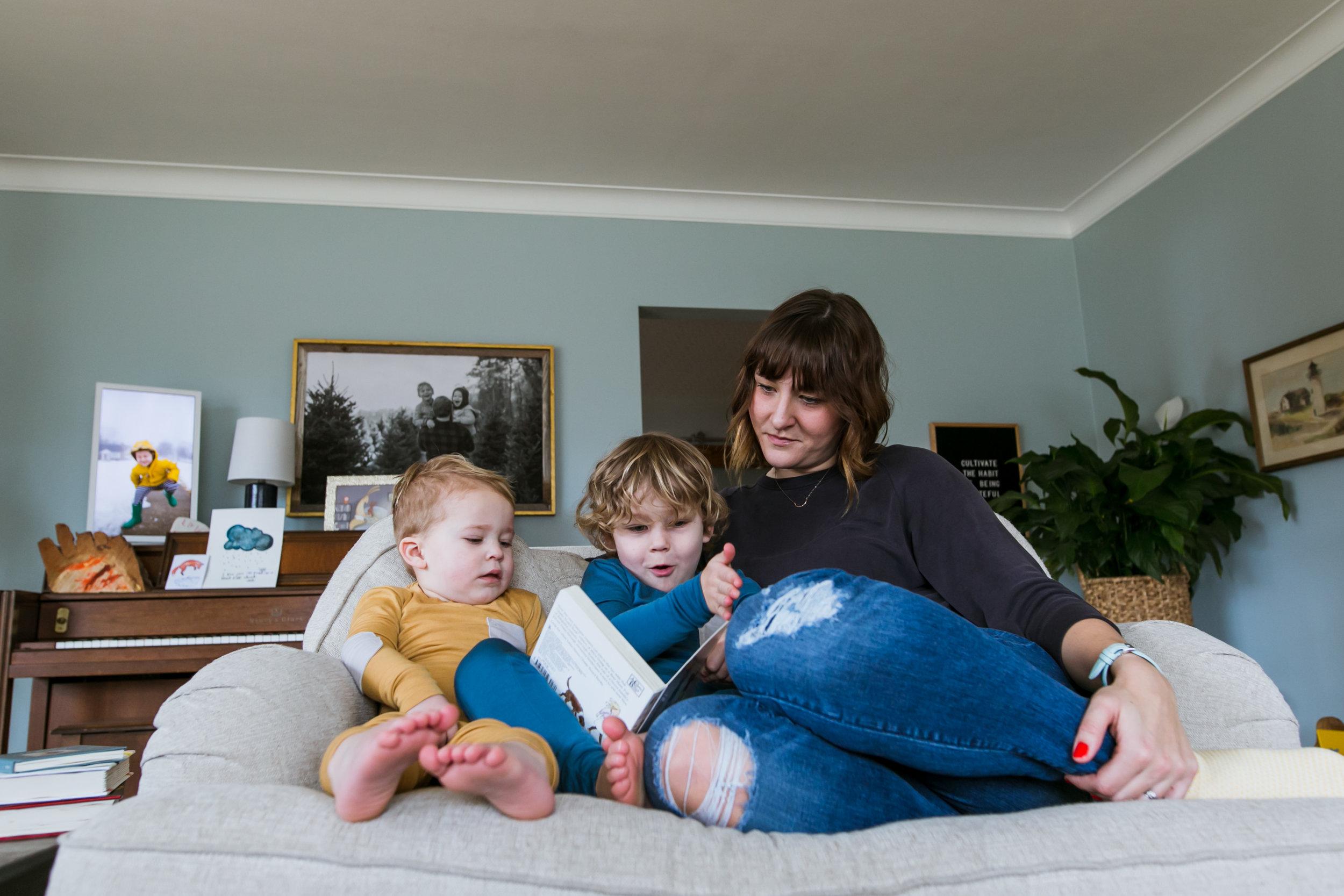 mom and 2 boys reading book, family film session mishawaka