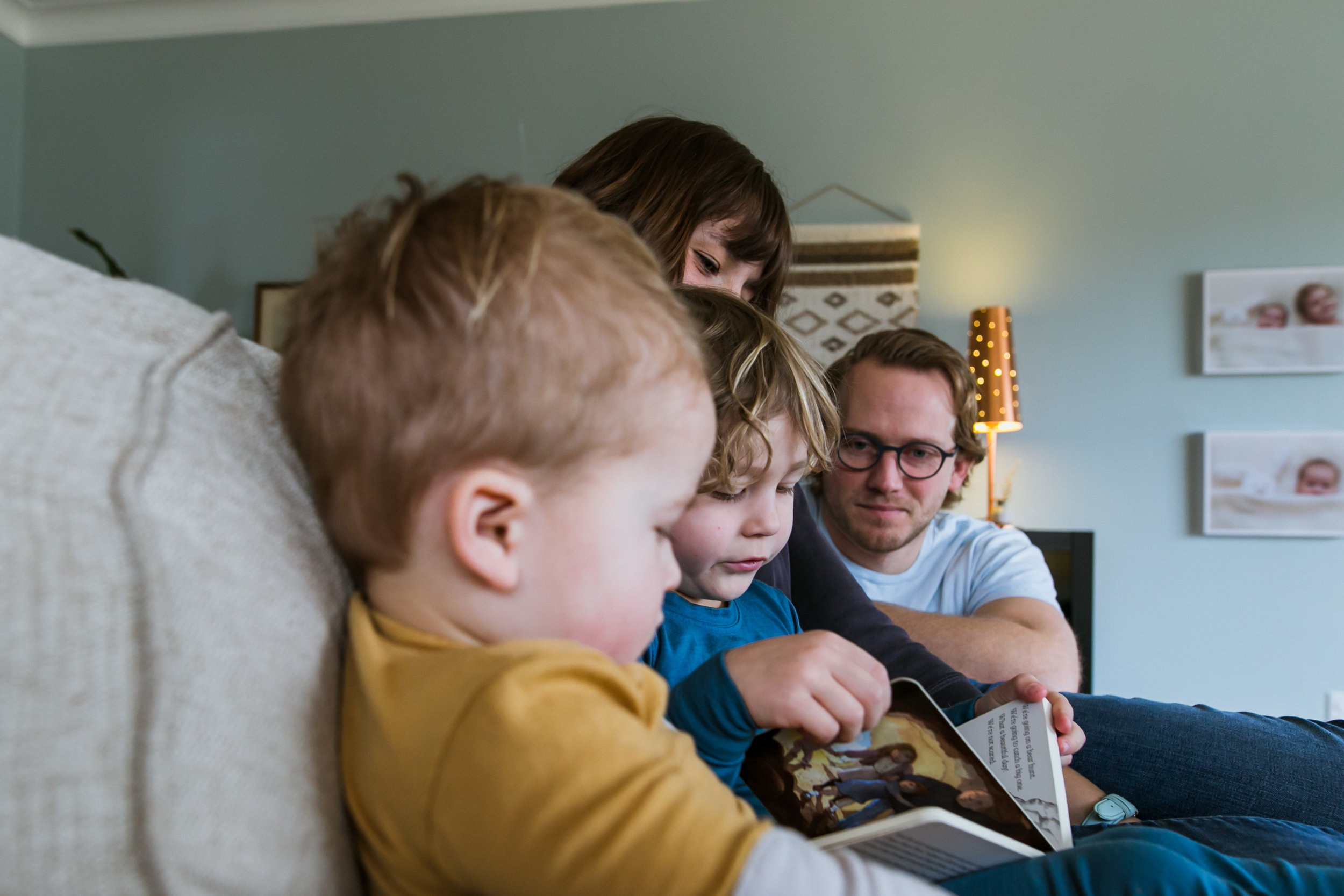 mom, dad and two sons reading book, family film session mishawaka