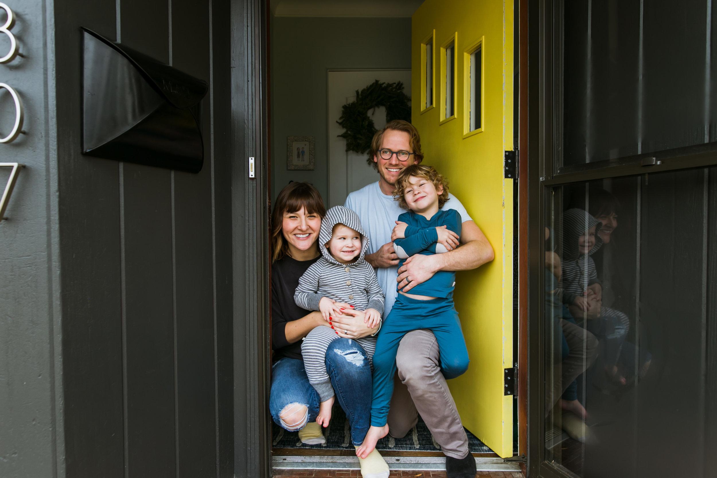 family at yellow door, family film session mishawaka