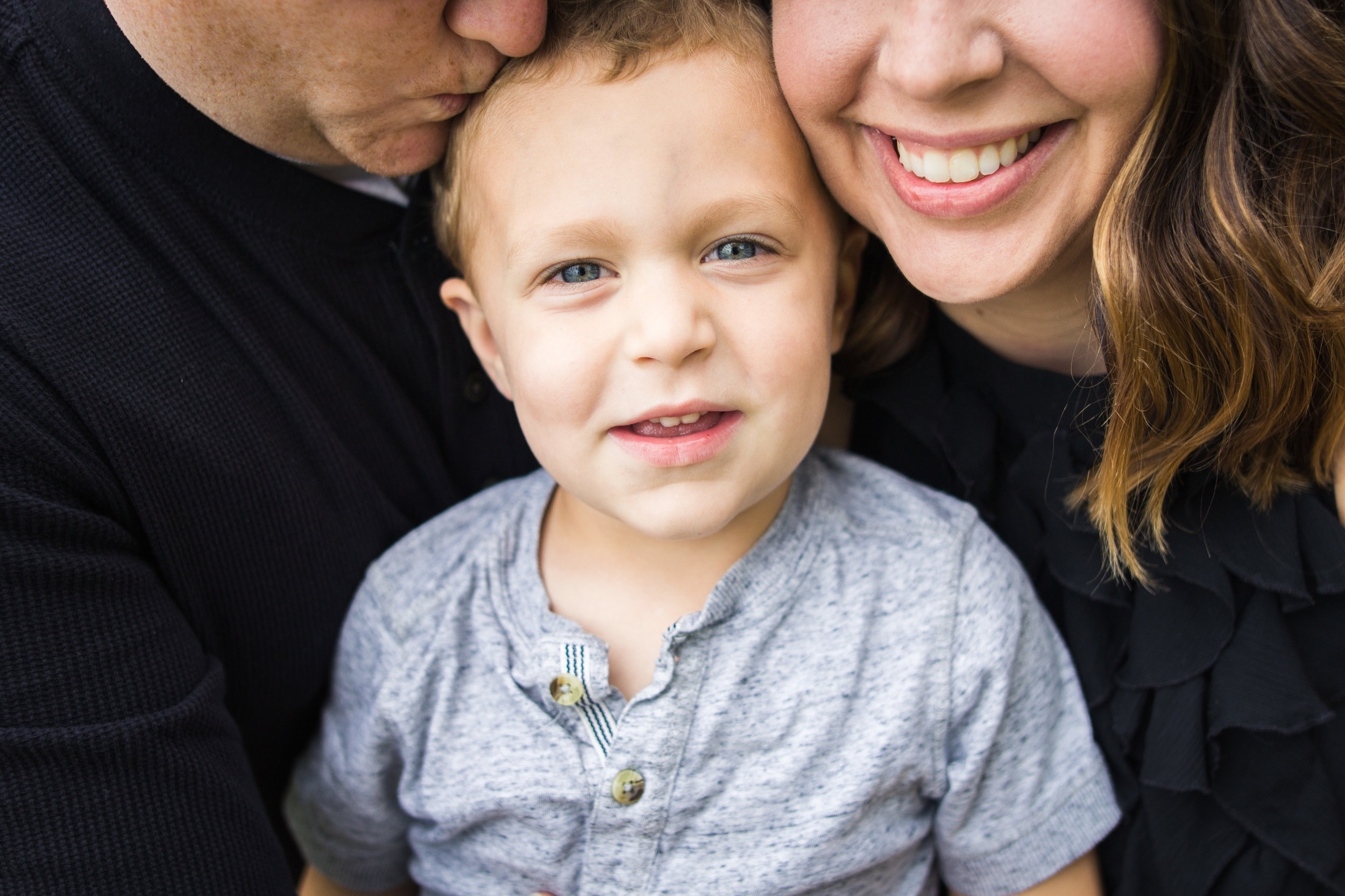 Close up shot of immediate family during photos
