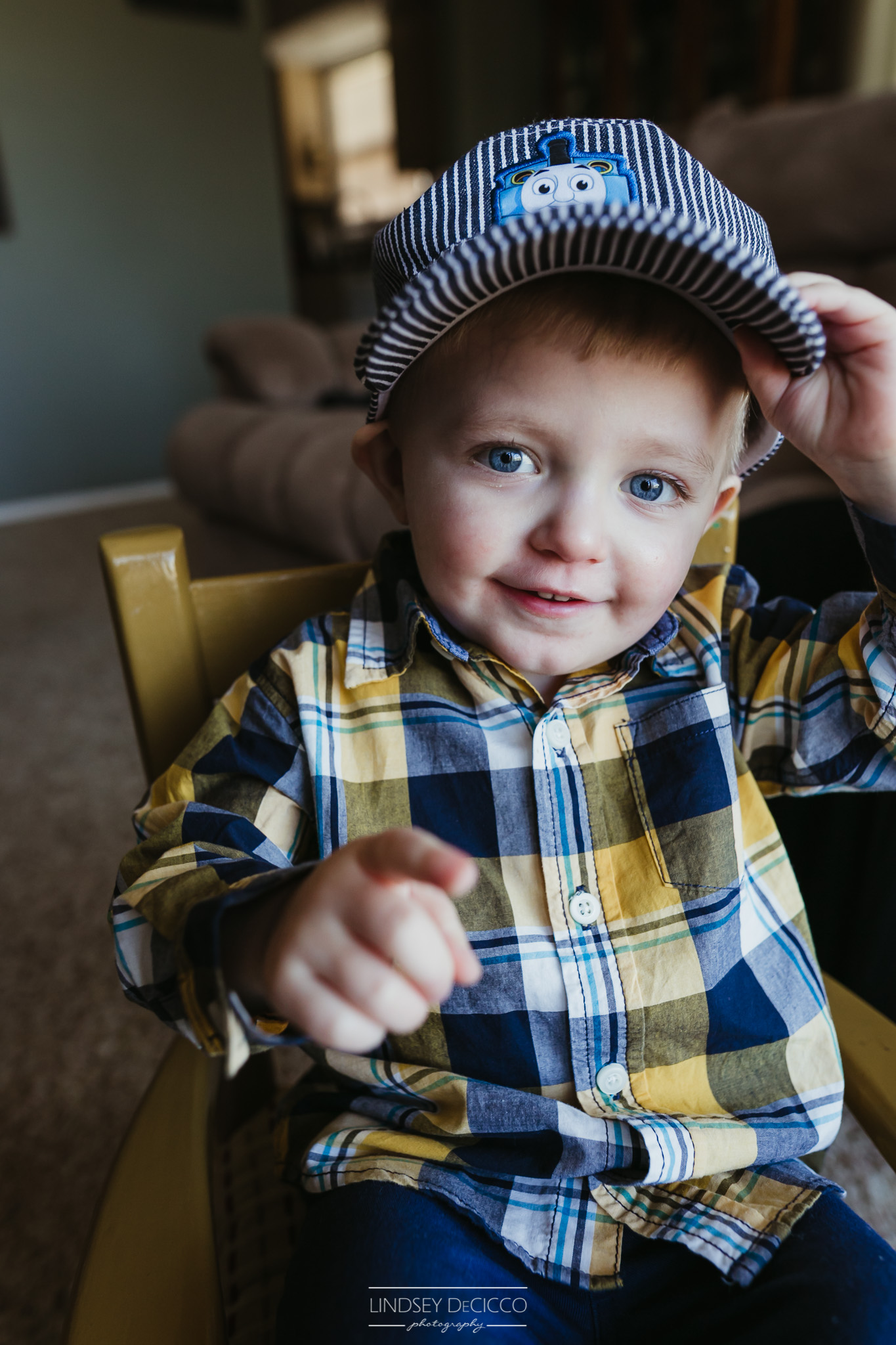 toddler in Thomas the Train hat
