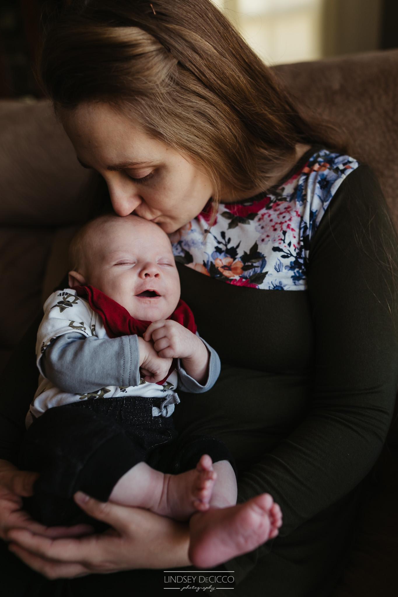 Mom kissing Newborn Baby