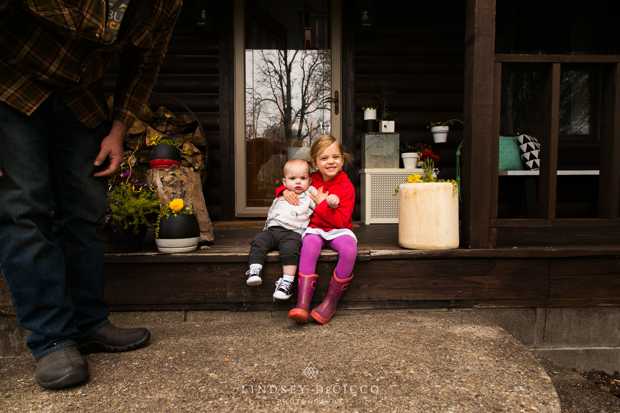 son and daughter on front porch of cabin