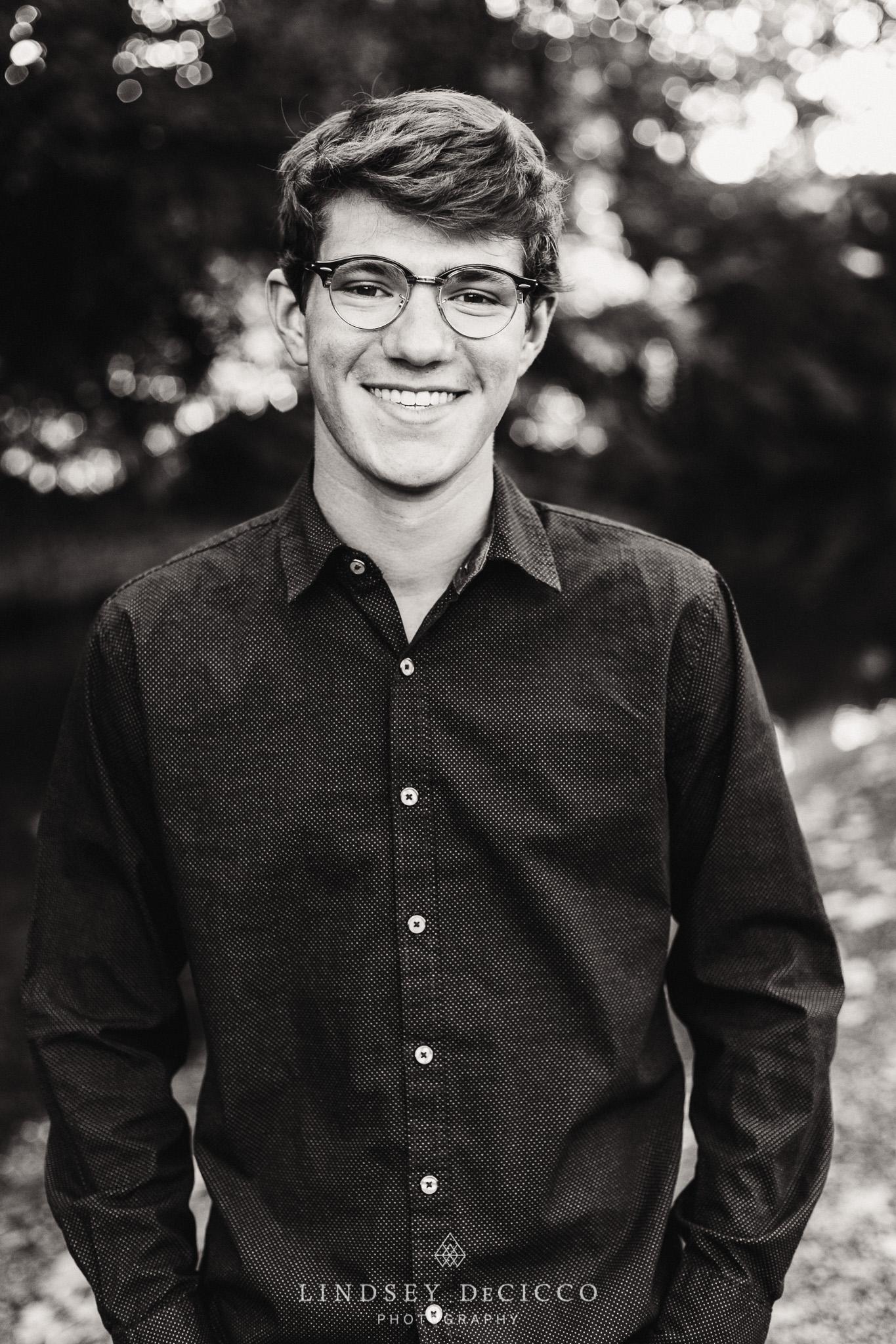Senior pictures backlit black and white