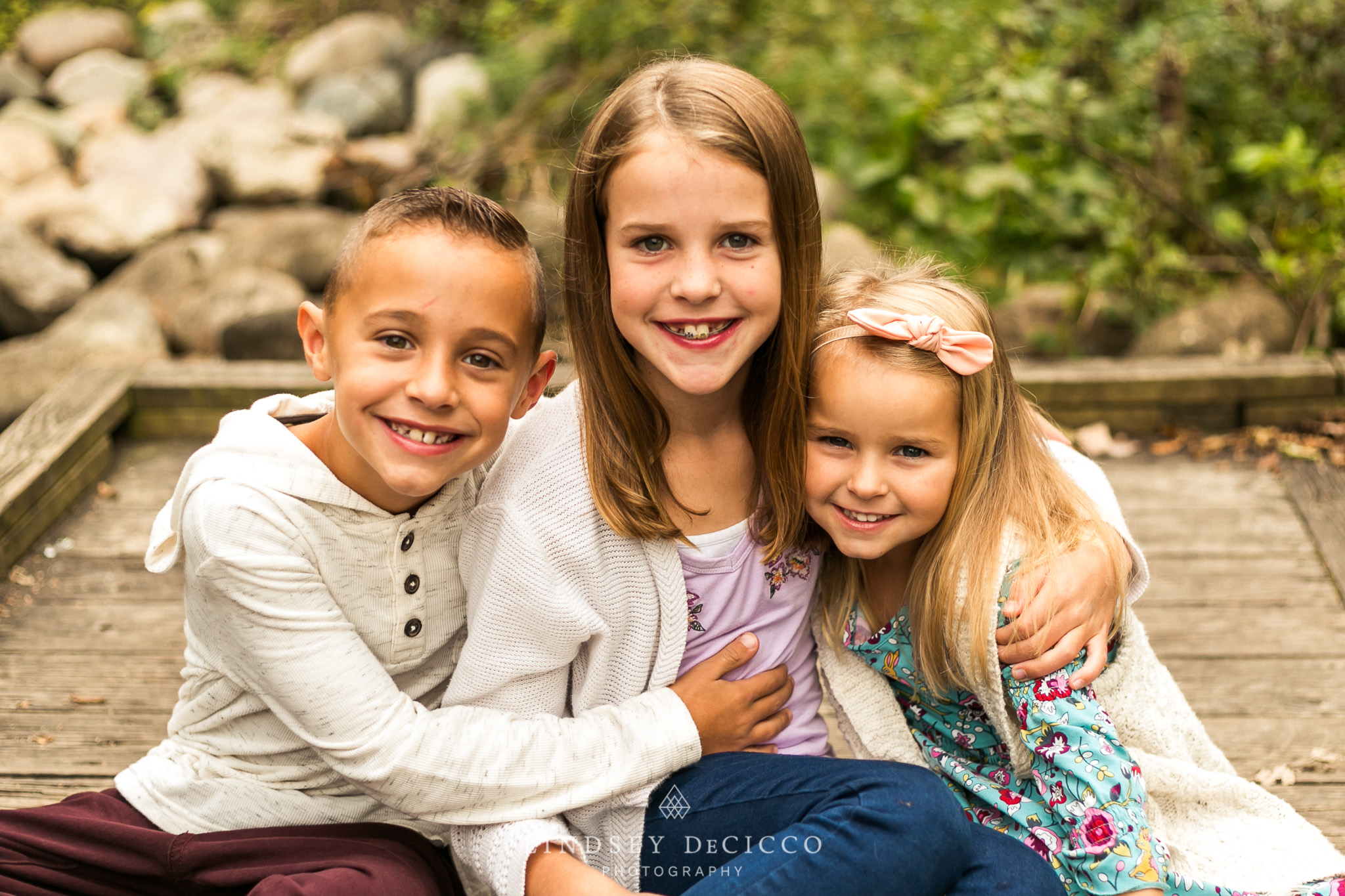 Siblings pose for 3 children