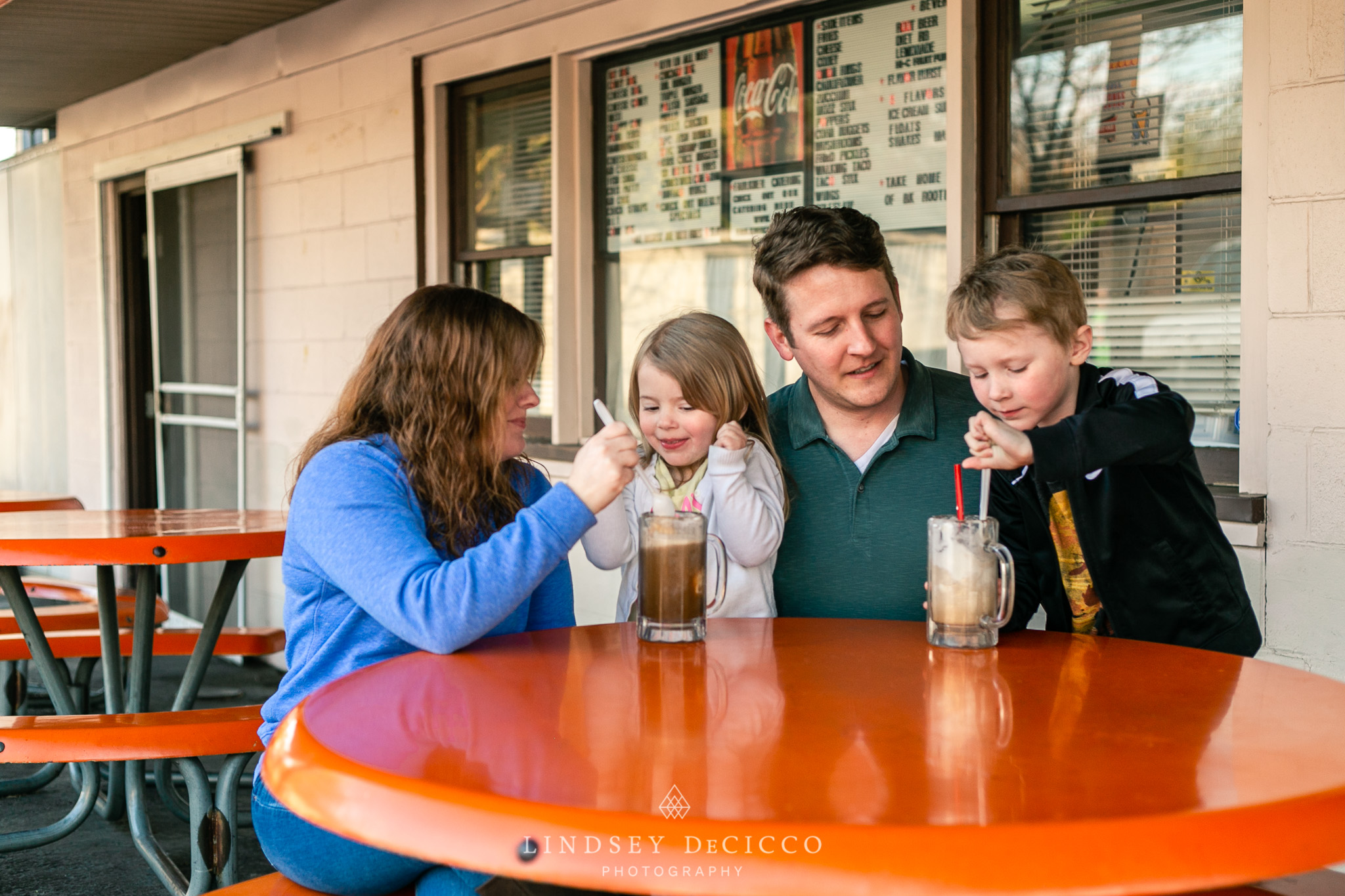 family enjoying the root beer stand