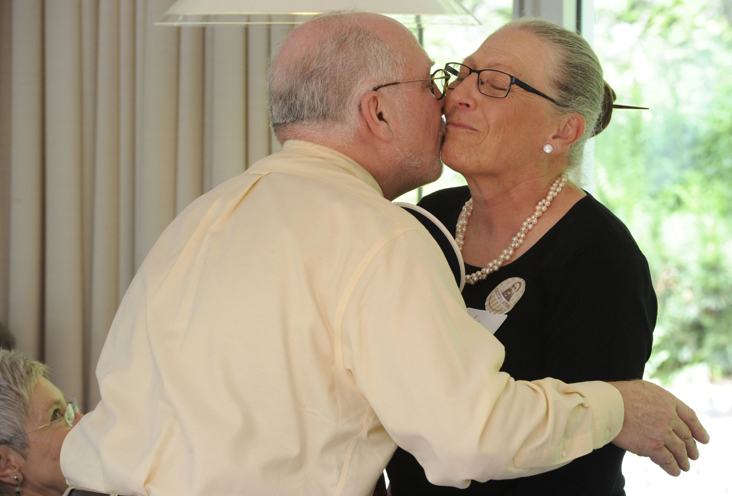 Jeb Wallace-Brodeur/Time Argus Staff Photo State Curator, David Schutz, gives Vivien Fritz of Marshfield a congratulatory kiss as she retires from being a long-time tour guide and coordinator.