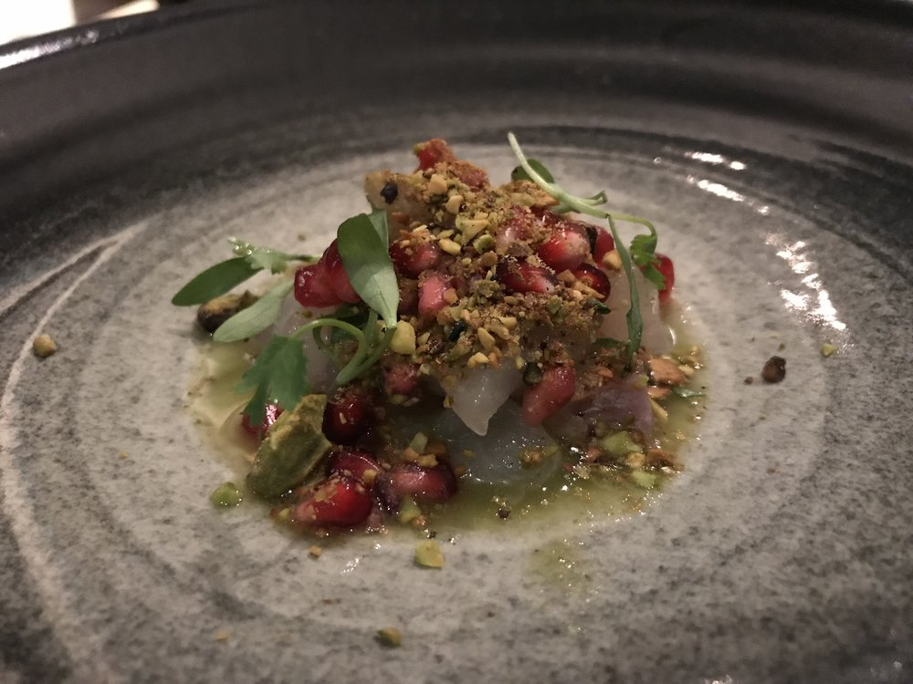 Cured local cod - Wrapped in seaweed, served with traditional Mexican-style ceviche with pistachios, pomegranate, lime juice, and microgreens