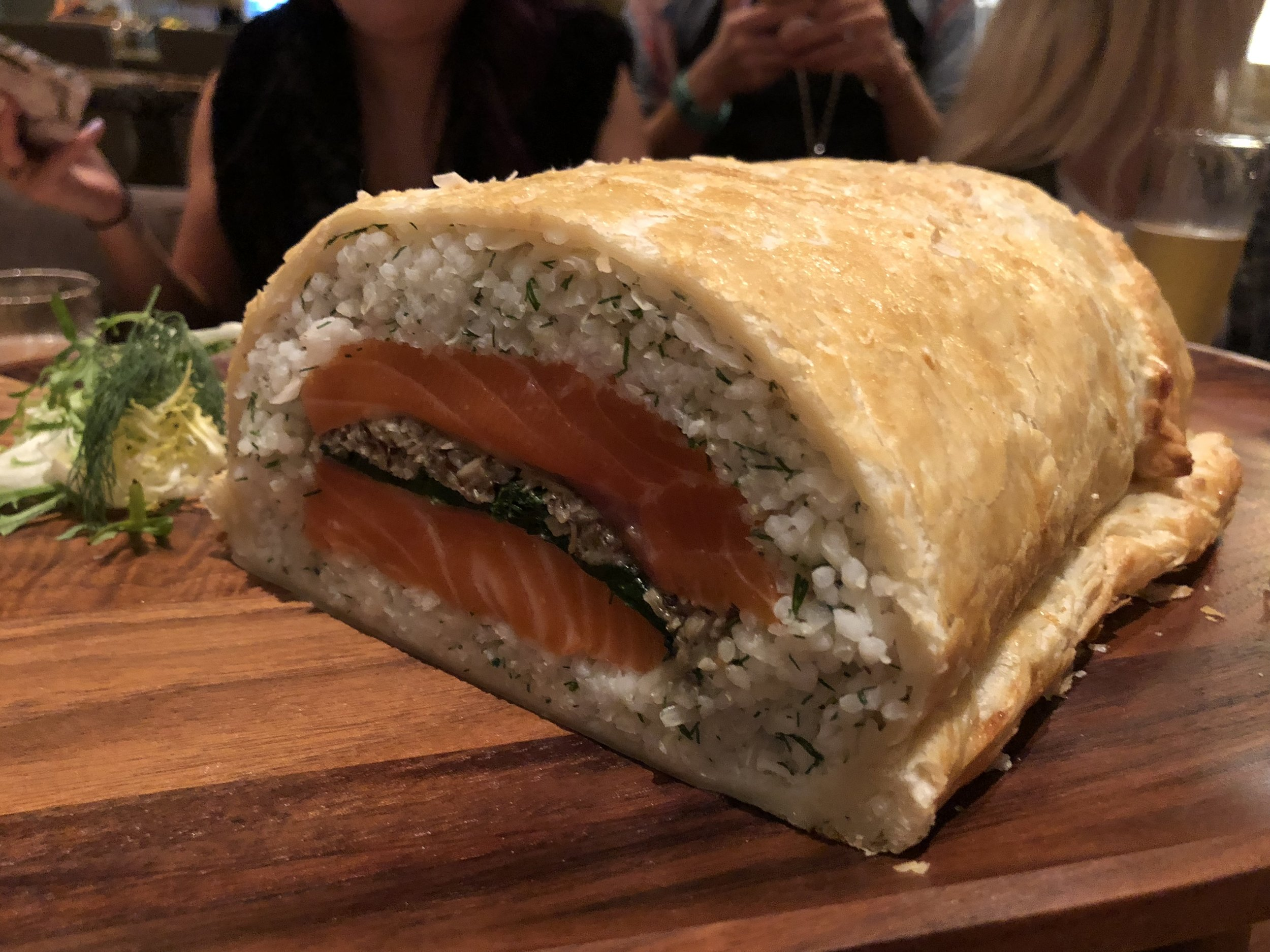 Salmon Koulibiac - Carolina Grit Rice. Cabbage. Mushroom Duxelle. Spinach. En Croute. Swedish Mustard.