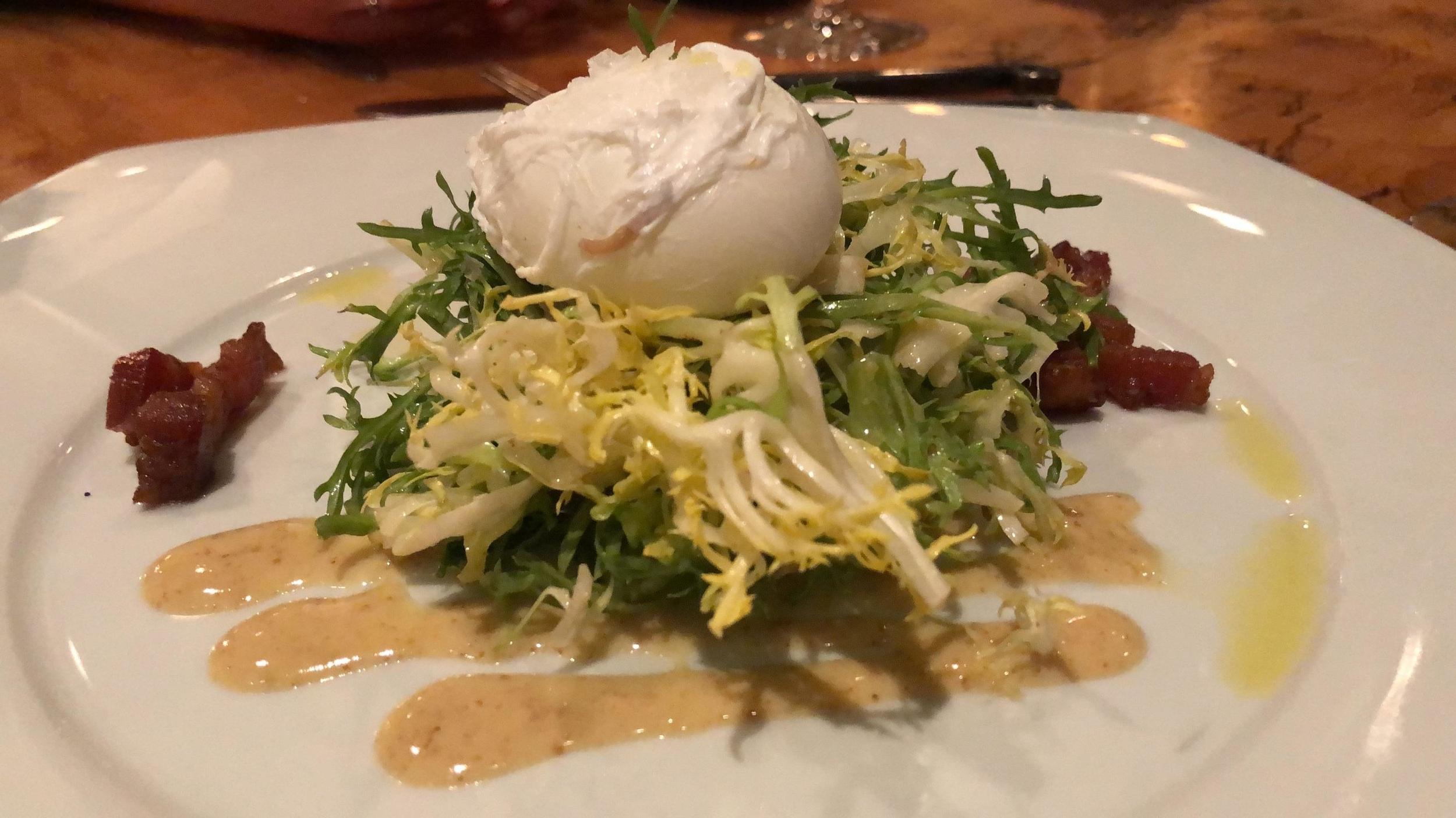 Lyonnaise Salad - Frisee. Benton's Bacon. Poached Egg. Mustard Vinaigrette.
