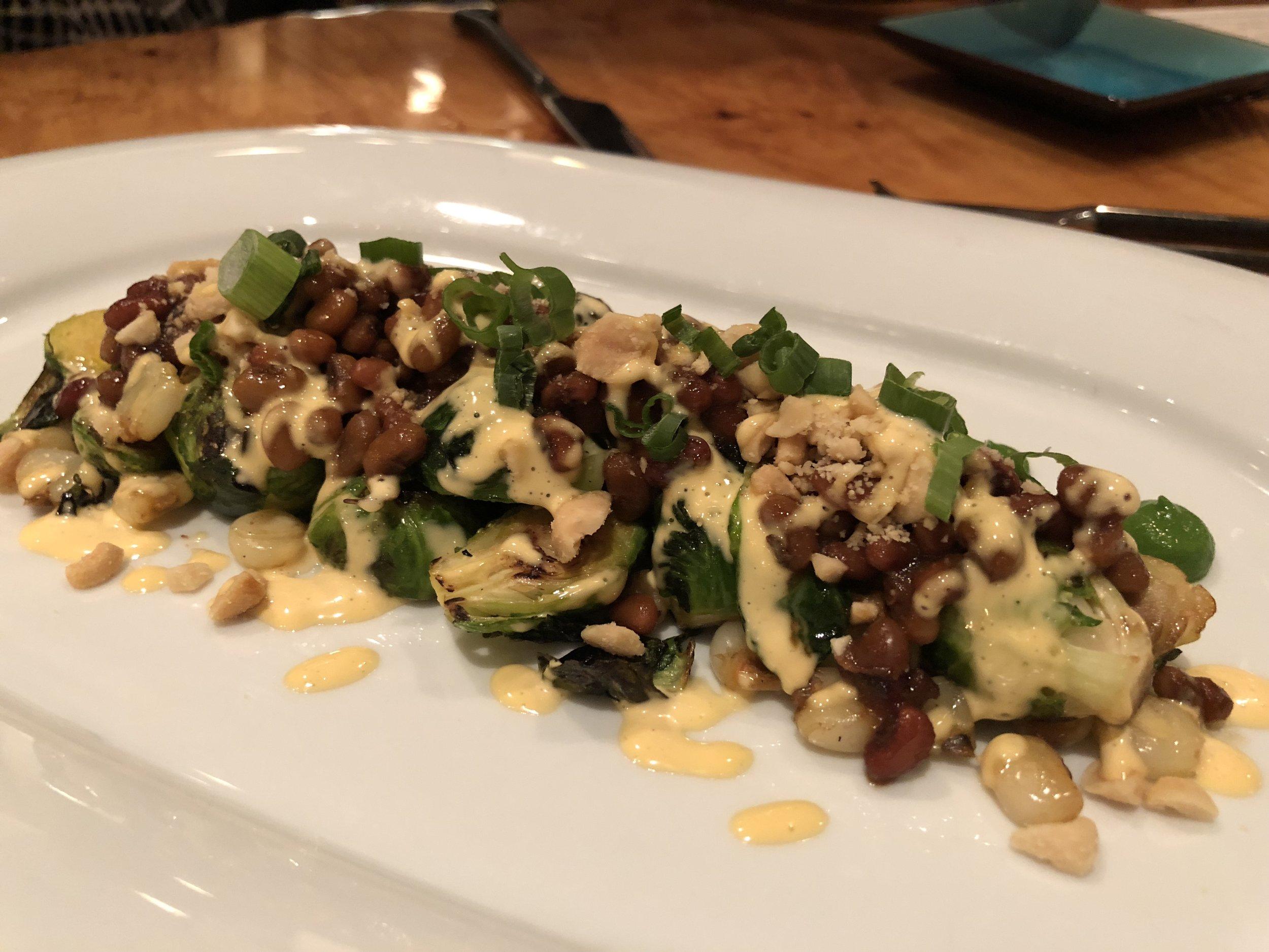 Brussels Sprout Salad - Sea Island Peas. Hominy. Peanuts. Tobago Aioli.