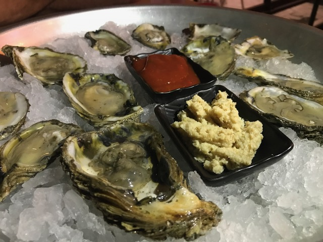 Raw Oysters - Kimchi cocktail sauce, white wine gochujang mignonette, lemon wedge