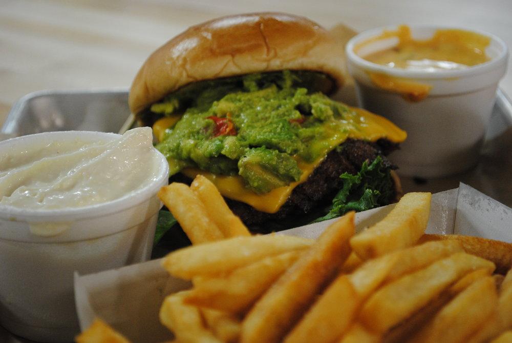 Gibralter Burger - American cheese, avocado, peppadew peppers, lettuce, onion, salsa verde