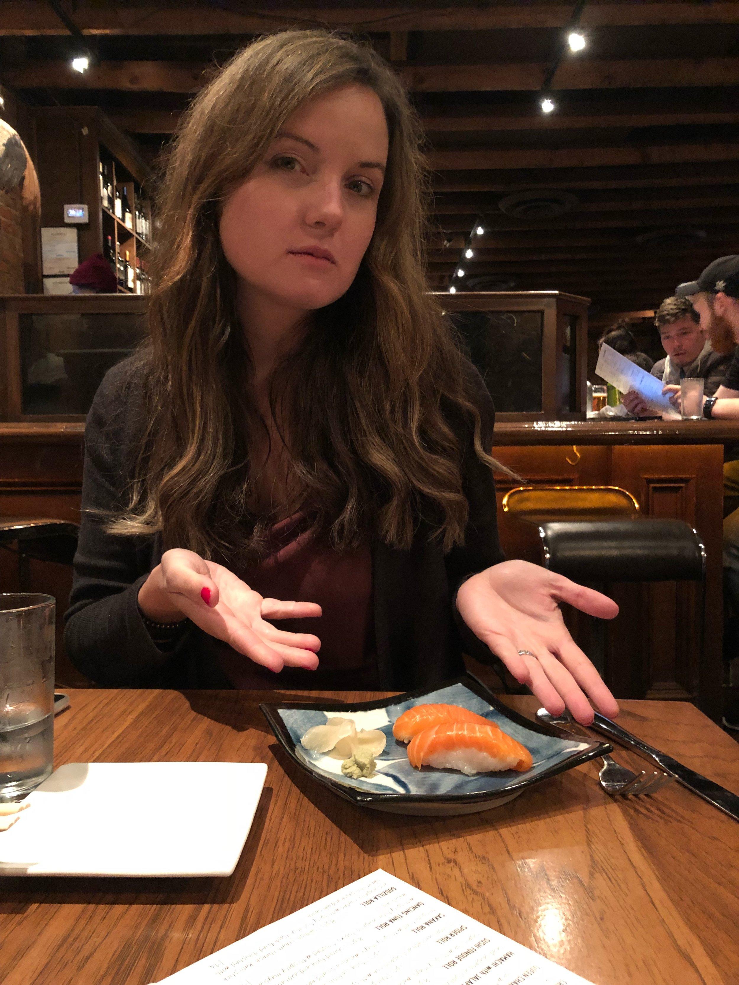 Vanna White sushi hands