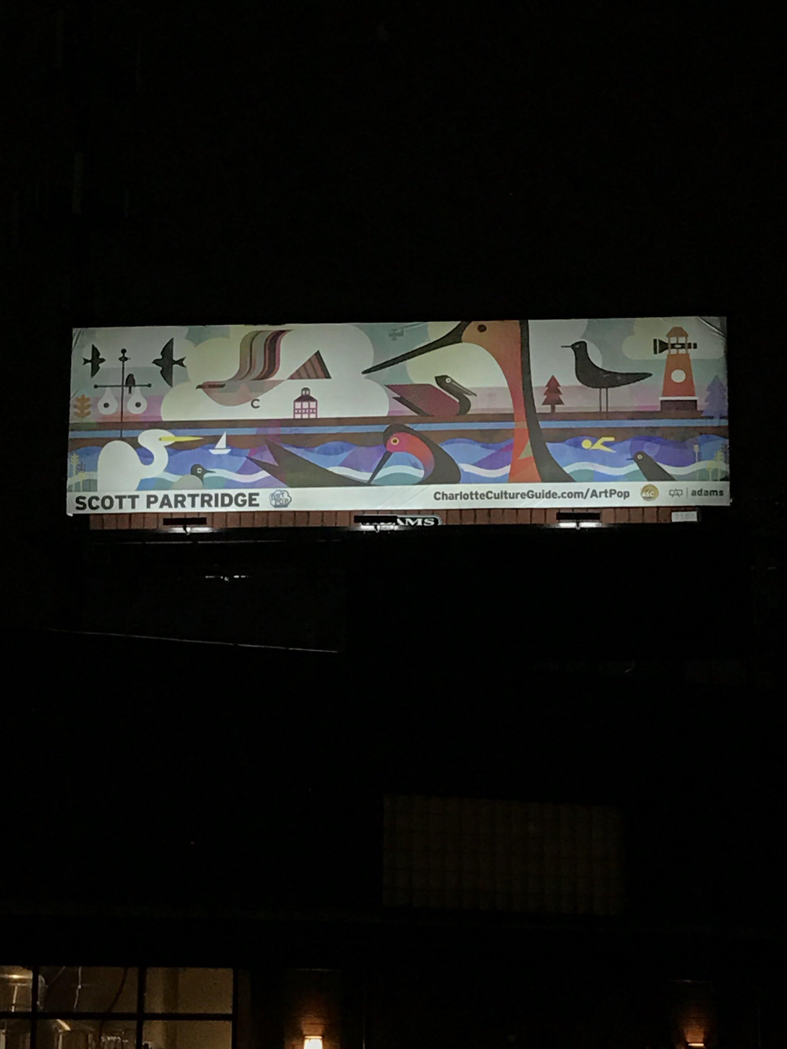 And on a billboard, sans pugs