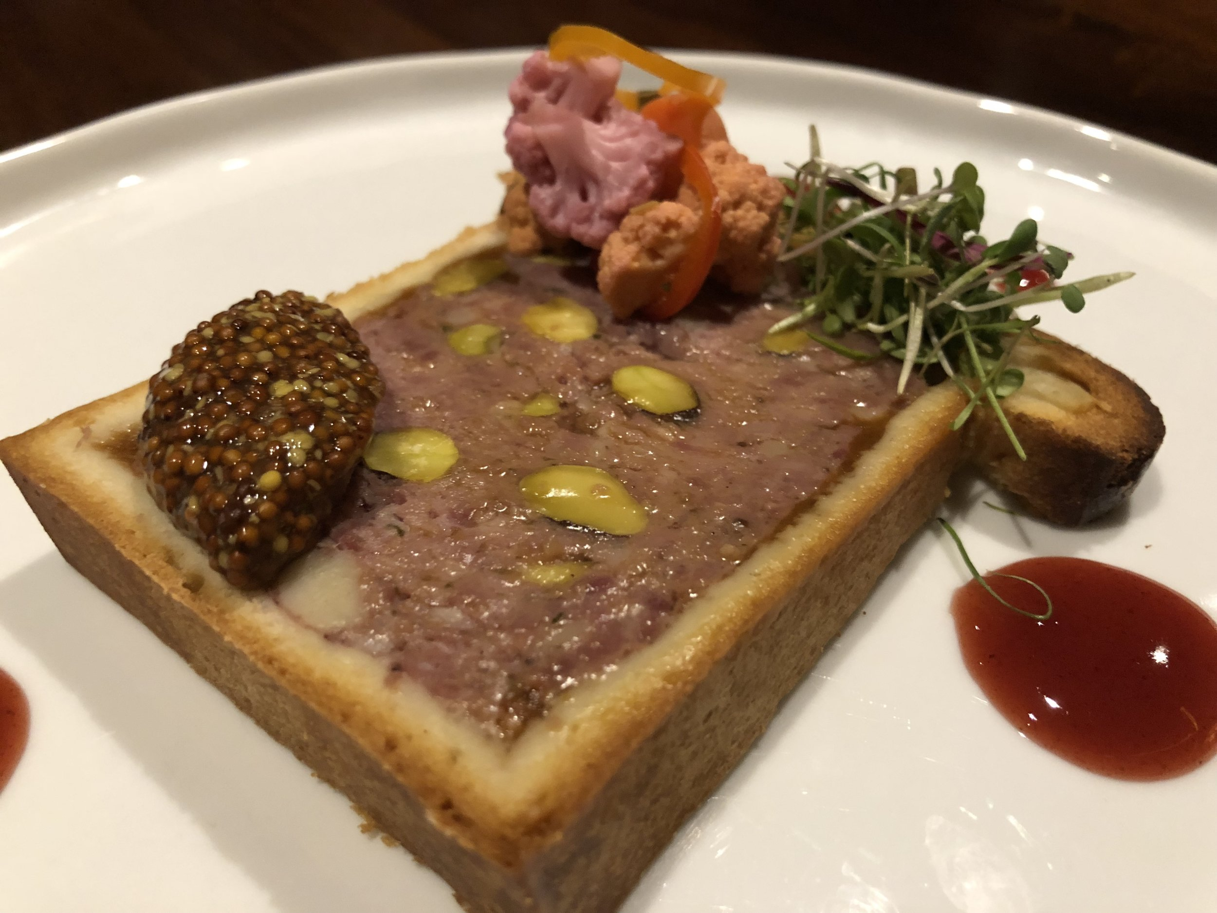 Pate en croute - moulard duck, pork, smoked duck ham, pistachio, savory pastry dough, pickled vegetables, dijon mustard, cumberland sauce