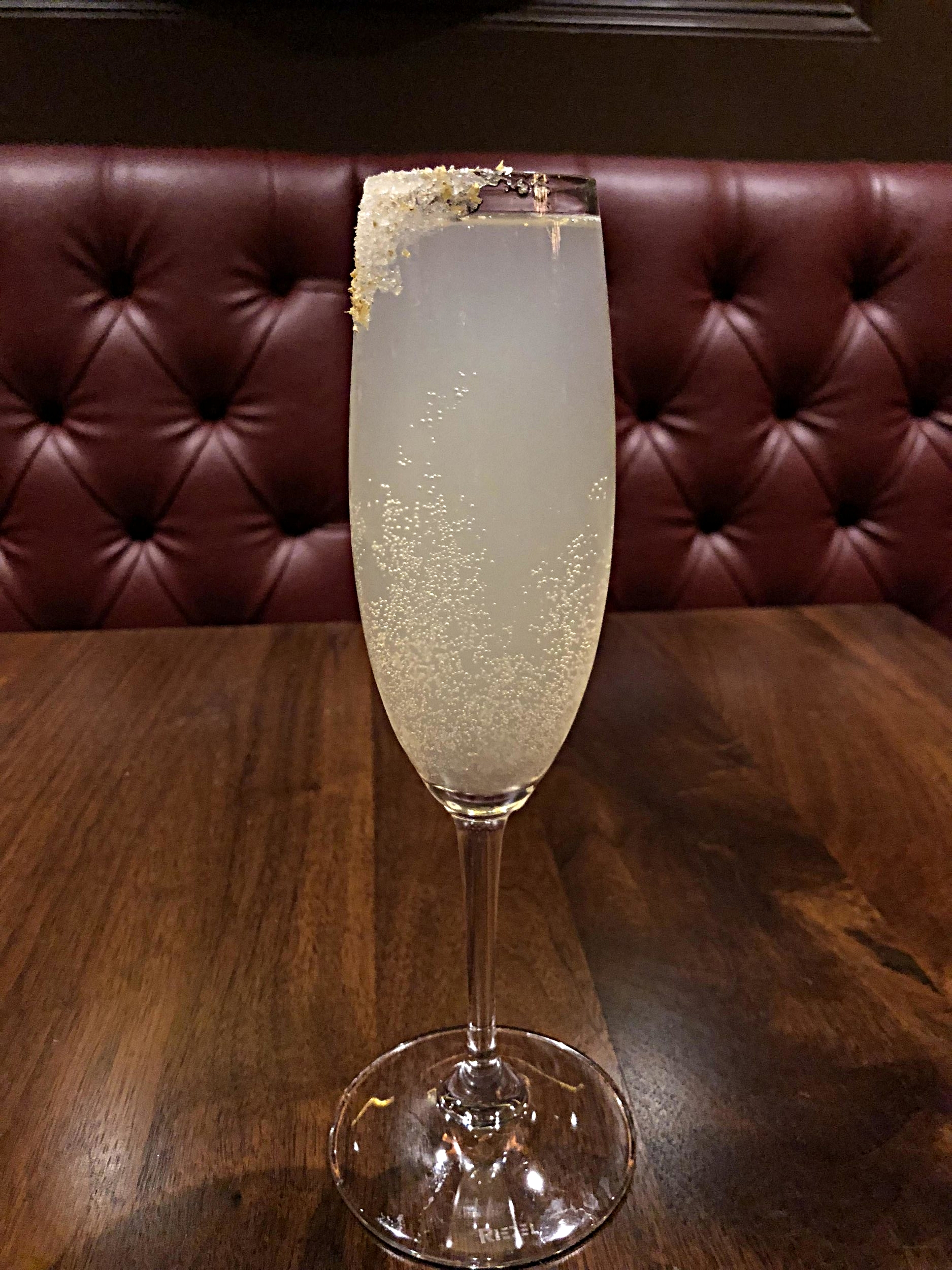 French-75 - Sutler's gin, lemon juice, simple syrup, champagne, served up