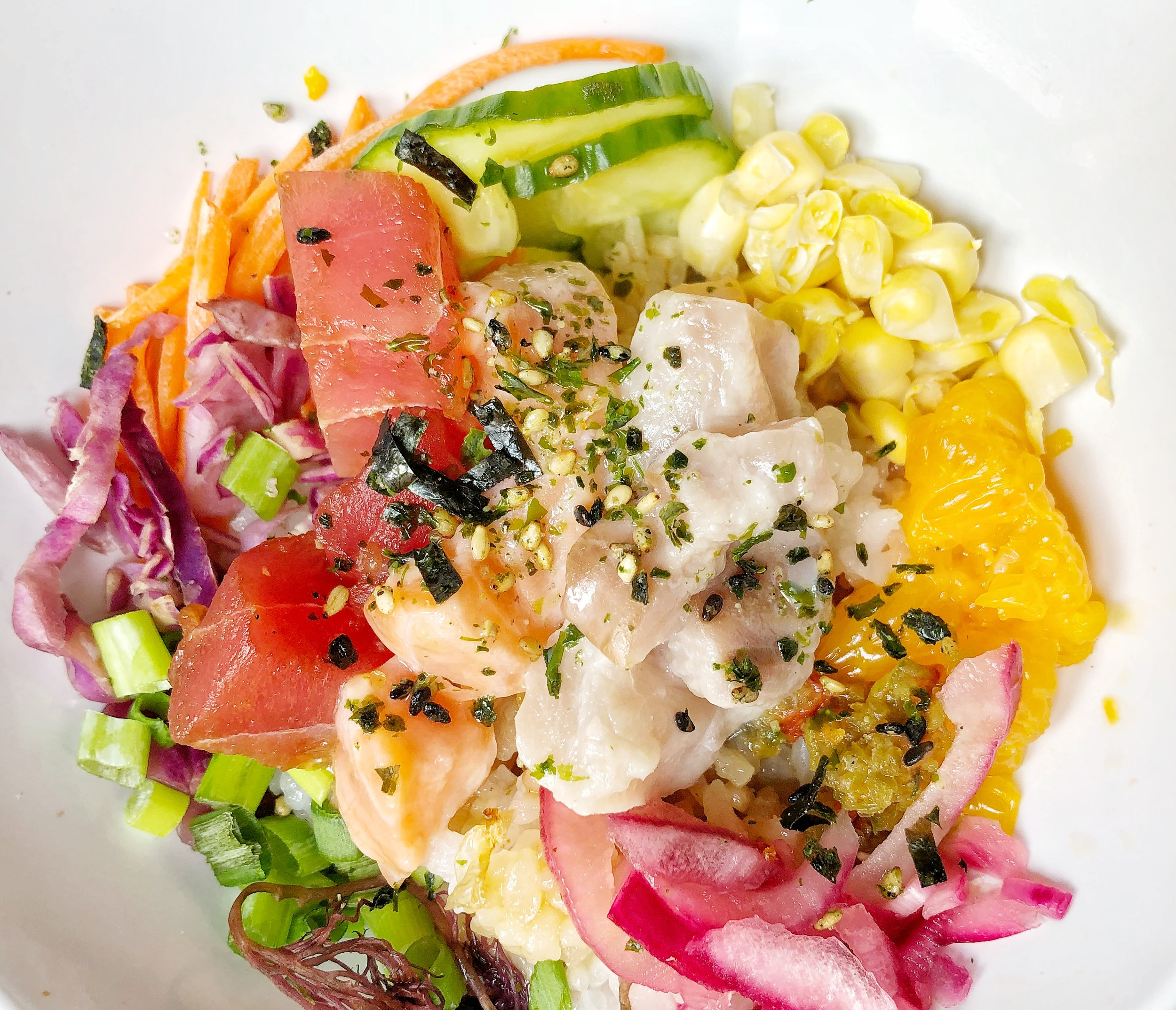 Rainbow Poke Bowl - Salmon, Hamachi, Ahi Tuna, Scallions, Pickled Red Onion, Red Cabbage, Sweet Corn, Cucumber, Limu/Ogo, Carrots, Mandarin Orange, Jalapeno/Serrano Salad, Shuyu Sesame Oil, Seasoned Milky Queen Rice