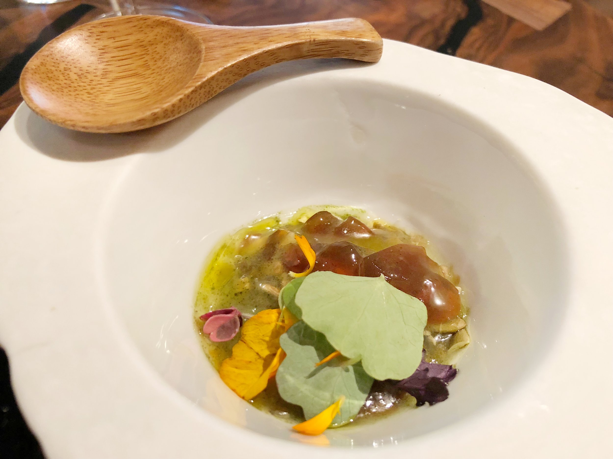 To bury in fallen leaves my treasures of the earth and sea - Seed & GrainSmoked buckwheat, quinoa soil, smoked trout roe (bottarga), and smoked sturgeon pearls with a warm bonito dashi broth. This course was rich and comforting.