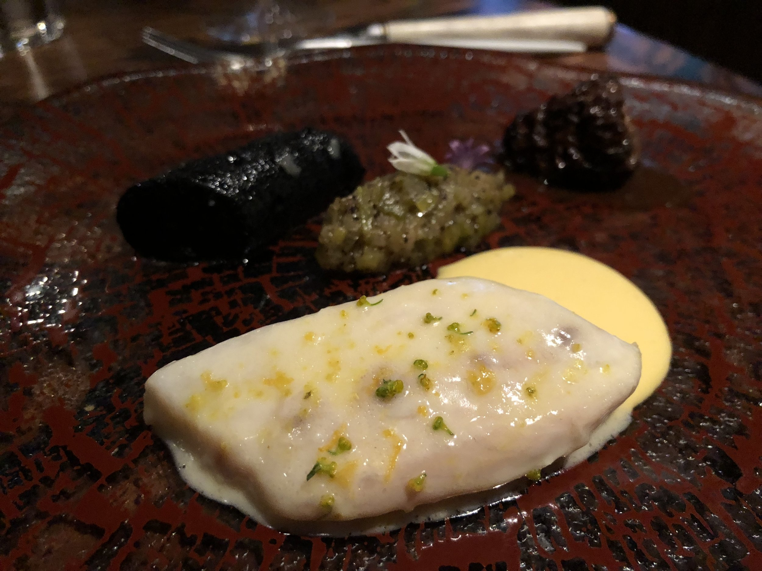 """To the snowy stillness of soft swimming creatures - Striped bass, Boudin Noir, & MorelThe best part of this course was that you got to choose your knife from a box of assorted knives a waiter brought around. I always loved '""""choose your own adventure"""" books, but choose your own cutlery was nearly as fun.You may have noticed that there is no meat on this menu. Once we had this course, I wasn't missing it at all. The sea bass was meaty and so rich. I felt very satisfied, but Jason wouldn't have hated a bit of red meat."""