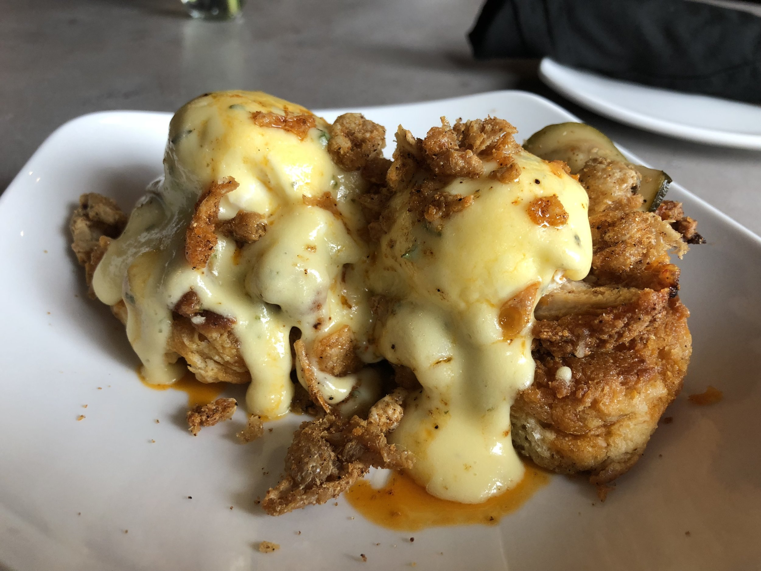 Hot Chicken Benedict - Hot fried chicken, buttermilk biscuits, poached eggs, herb hollandaise, zucchini picklesFabulously spicy and flavorful. A great twist on a traditional Benedict.