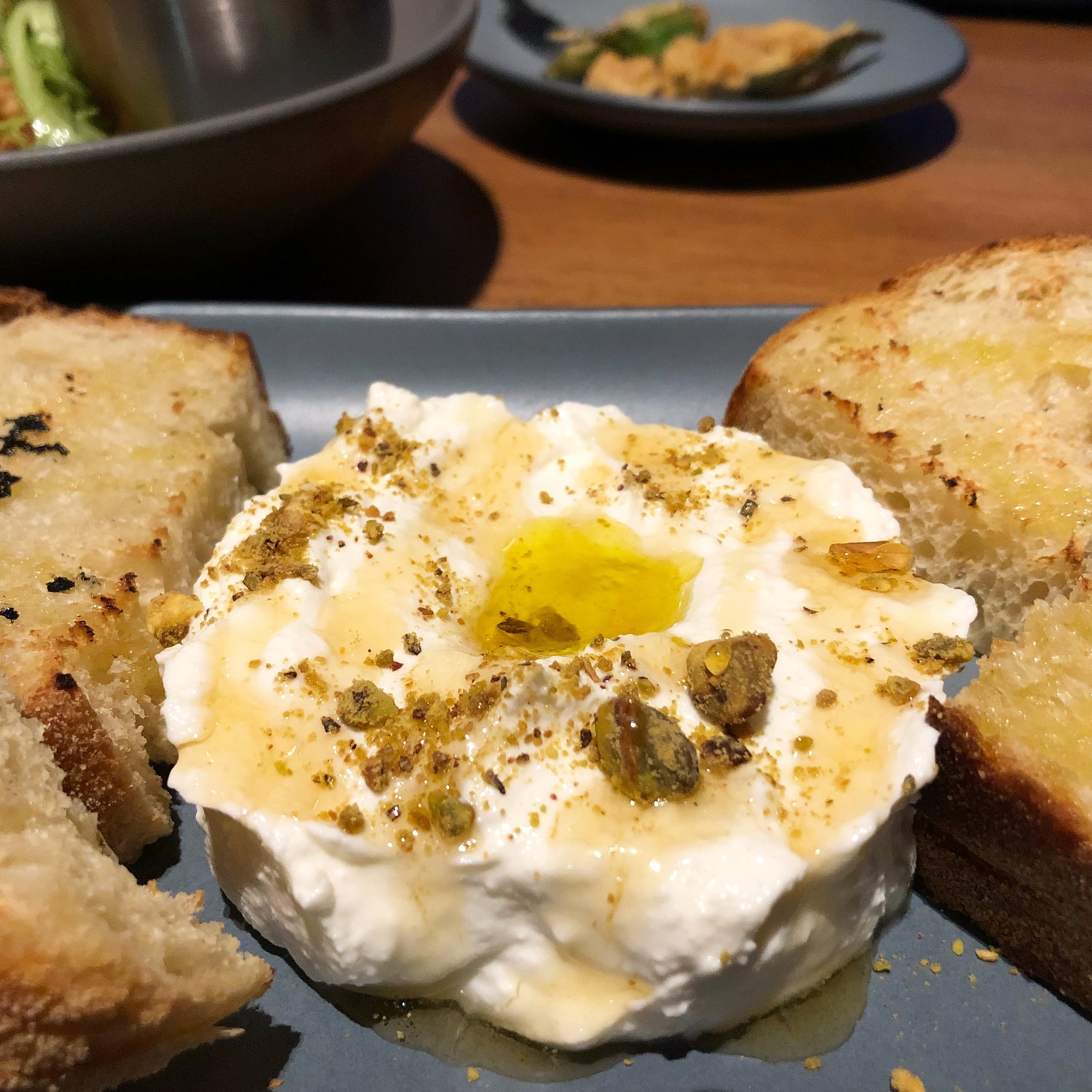 Whipped Ricotta - Sourdough, lavender honey, pistachioThe best appetizer on the menu. You can't come to Angeline's and not order this. You won't be disappointed.