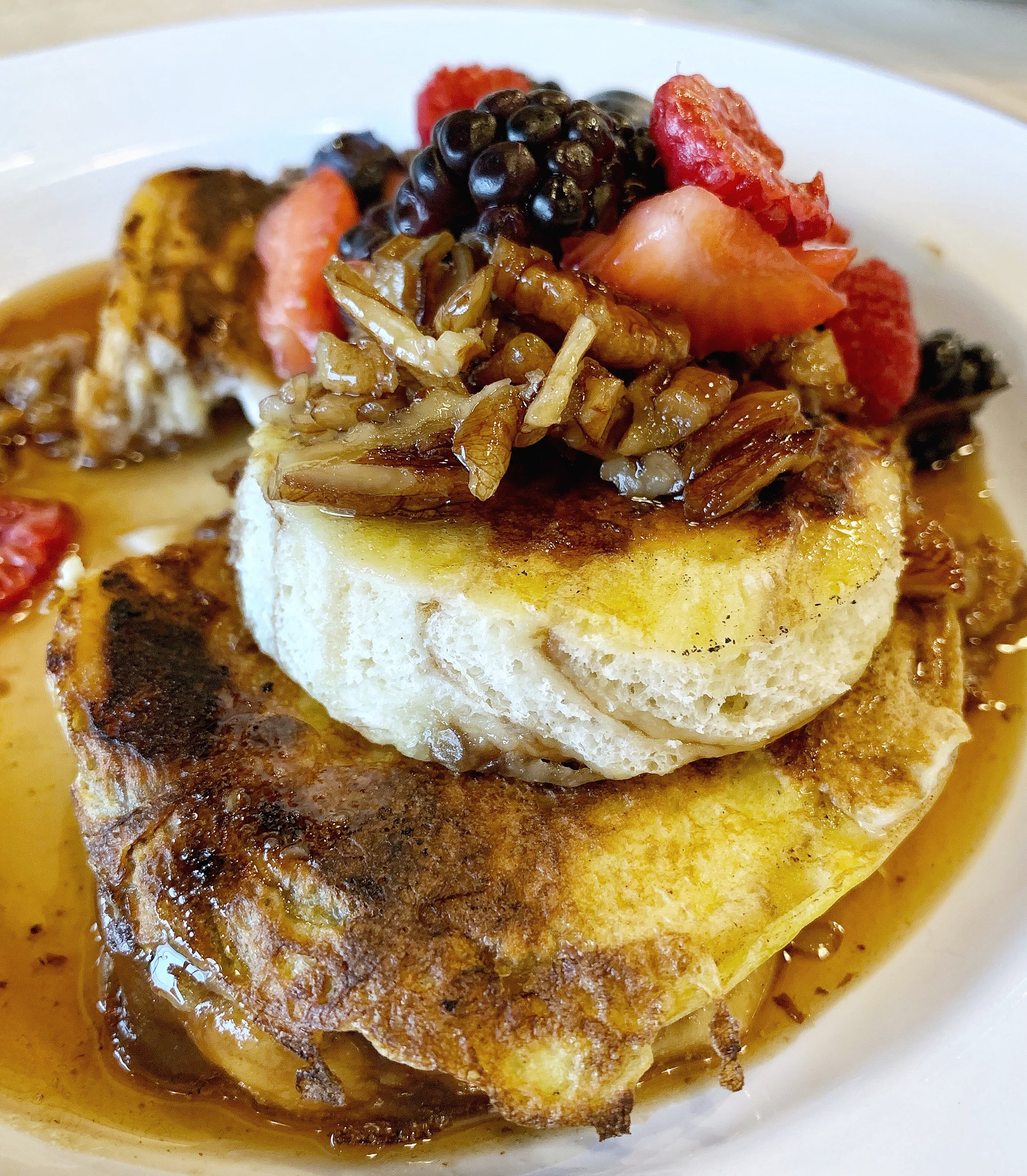 Stuffed French Toast - Cinnamon Babka French Toast stuffed with an over-easy egg, topped with berries and pecan maple syrupChef Alyssa is our Jewish soul sister, and she and Jason went to the same temple growing up! So, this babka French toast is a nod to one of the best Jewish culinary creations there is. If you've never had babka, you're missing out. And babka a la French toast is a great way to enjoy this classic.