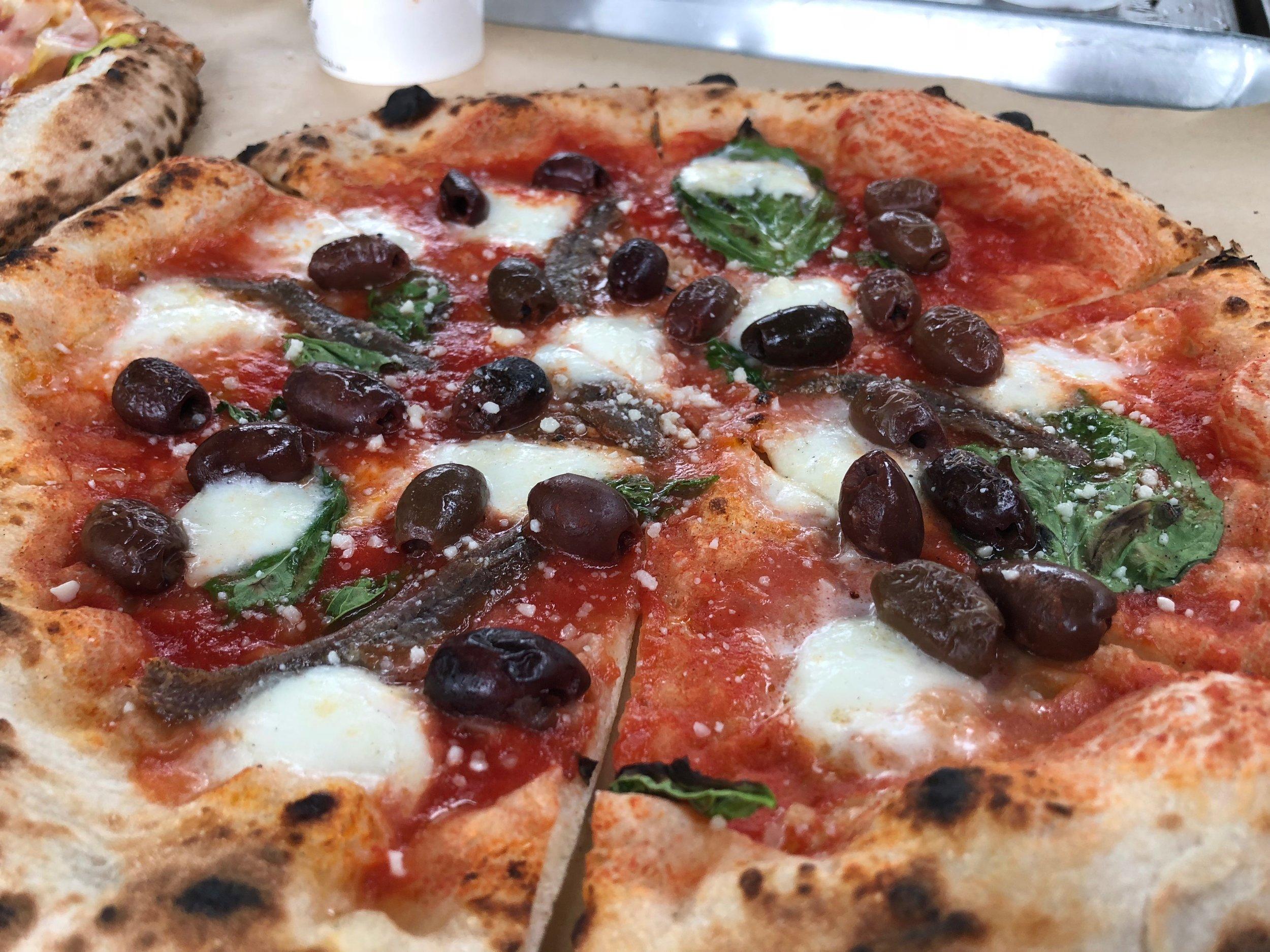NAPOLETANA - Anchovy, Kalamata olives, San Marzano tomato sauce, Buffalo Mozzarella, basil