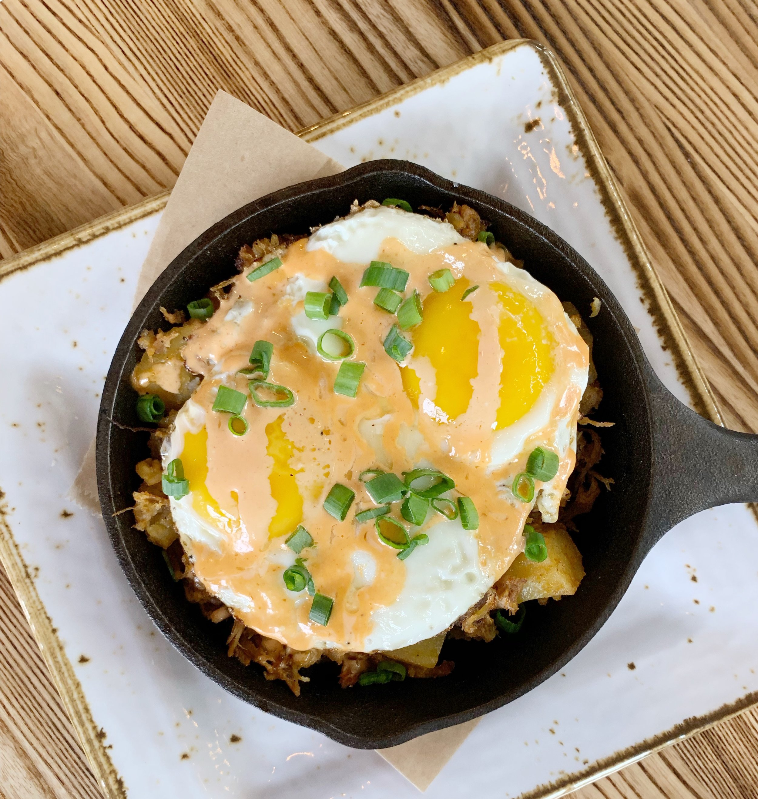 The CUre - Roasted pork hash skillet with baked egg, green onions, and Legion hot sauce aoiliThis is one of the most popular brunch items, probably because hungover people love potatoes. And really, who doesn't? This is a classic brunch dish, and we really liked the aioli.