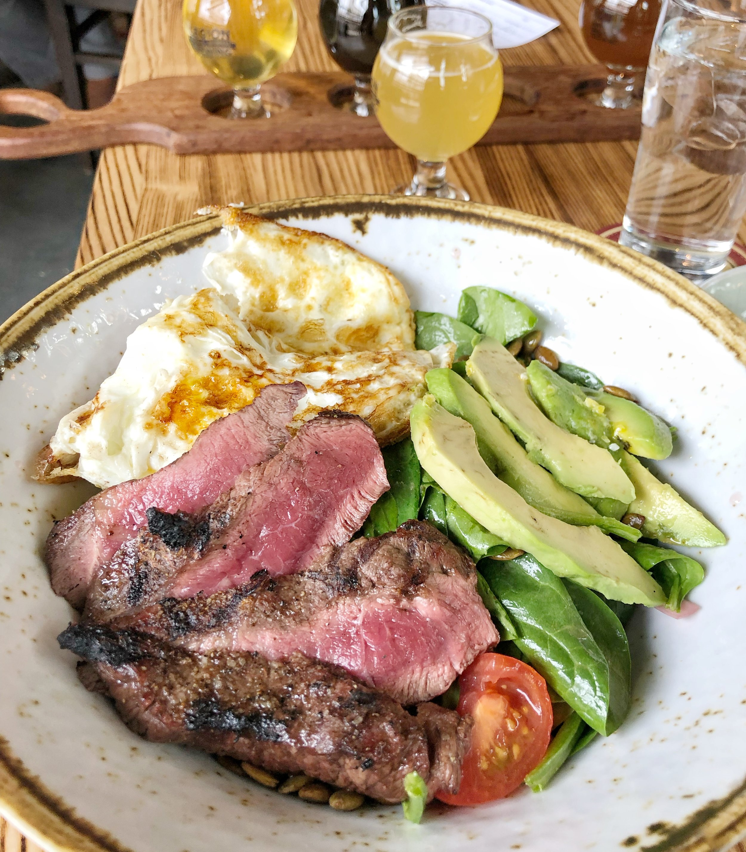 Baby Spinach & Avocado Salad With Steak - Fresh baby spinach, ripe avocado, Campari tomatoes, pickled red onion, toasted pumpkin seeds with an orange lime dressingLove the amount of avocados and eggs on the menu. I felt so strong after this brunch, like I could lift a car off a baby (or a baby pug). And now steak! My protein cup runneth over. I would order this again, but I would like to sub out the spinach for another lettuce, because I firmly believe that spinach only belongs in a smoothie and/or out of my life forever.
