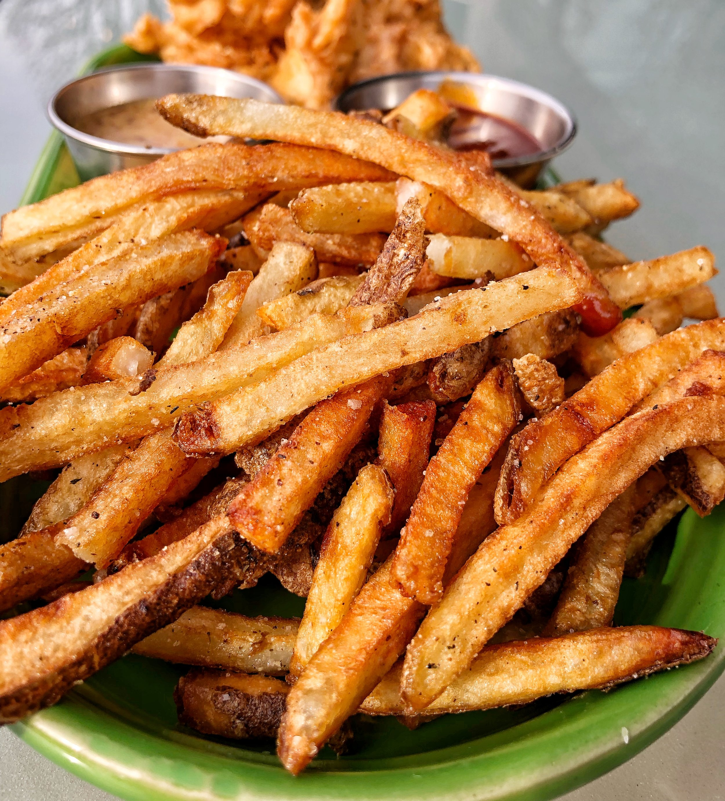 House-Cut Fries - These fries take two days to make. They are cut in house, brined, and then fried up to absolute perfection. That golden-brown color isn't fry face tune, it's just the mark of a potato treated right. Don't expect to be able to share these with anyone.