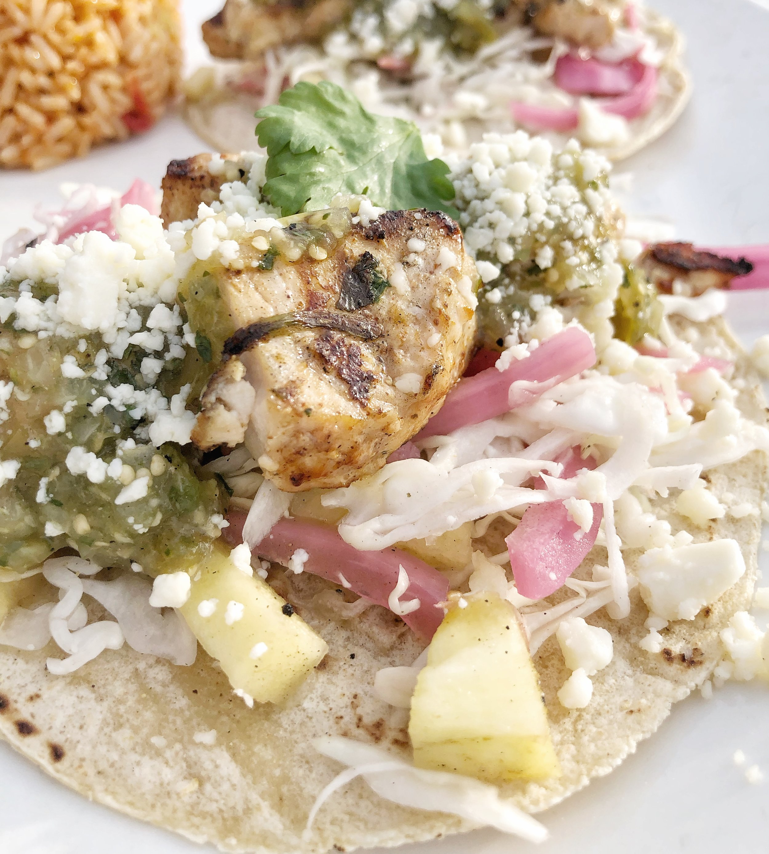 StreetSide Grilled Fish Tacos - Grilled white fish, fresh corn tortillas, grilled pineapple pickled onion, salsa verde served with Spanish rice & black beansDid someone say Taco Tuesday? Who wants to crowd into the same old tired taco joint as the rest of Charlotte when you can get these beauties? That's what I thought.
