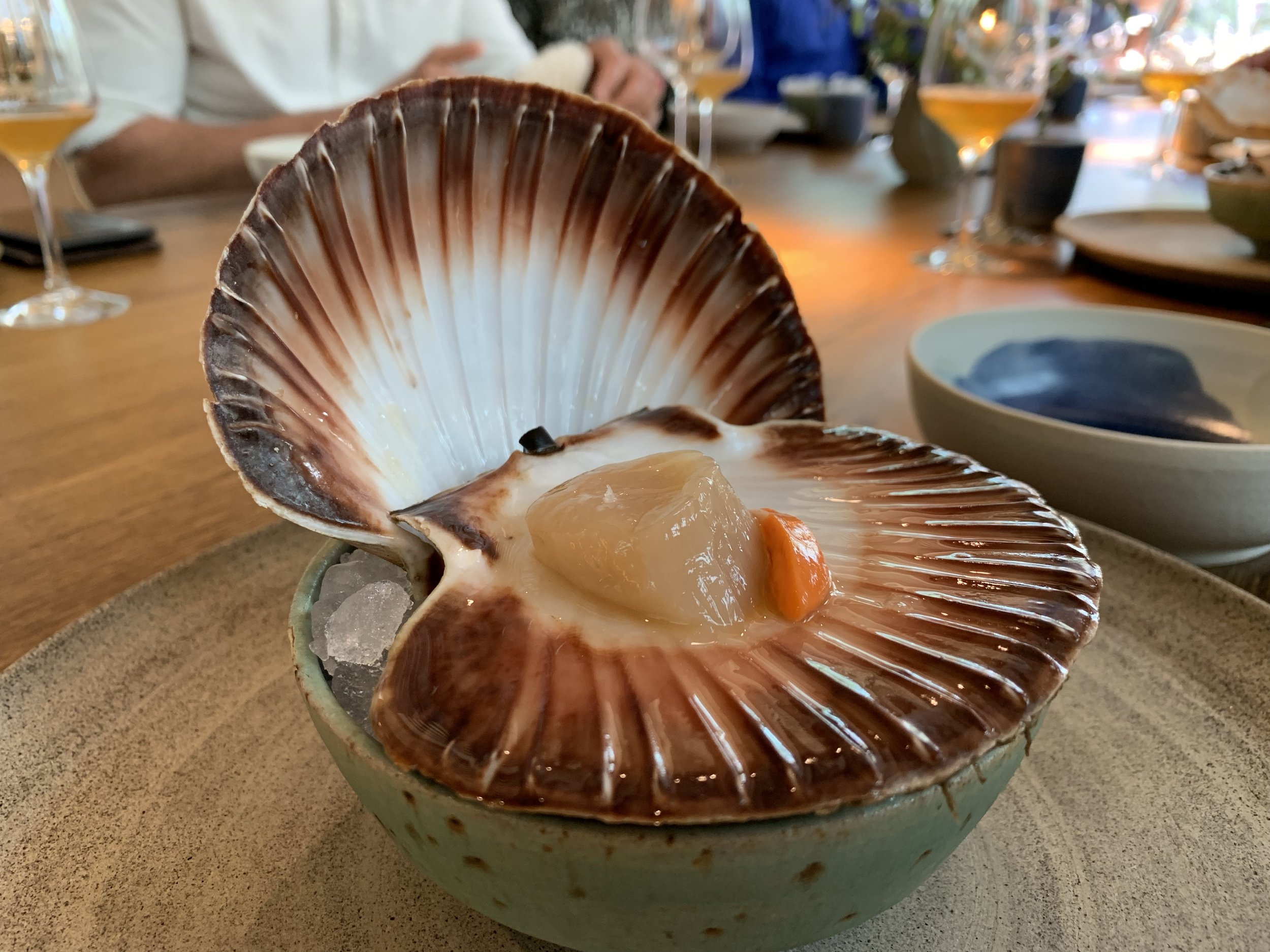 Fresh Norwegian Scallop - As you walk in, you can see the chefs opening the scallops to keep them as fresh as possible. They were delivered to our table and we were instructed to use the top part of the shell as a fork to scrap off the scallop and eat it with its roe.