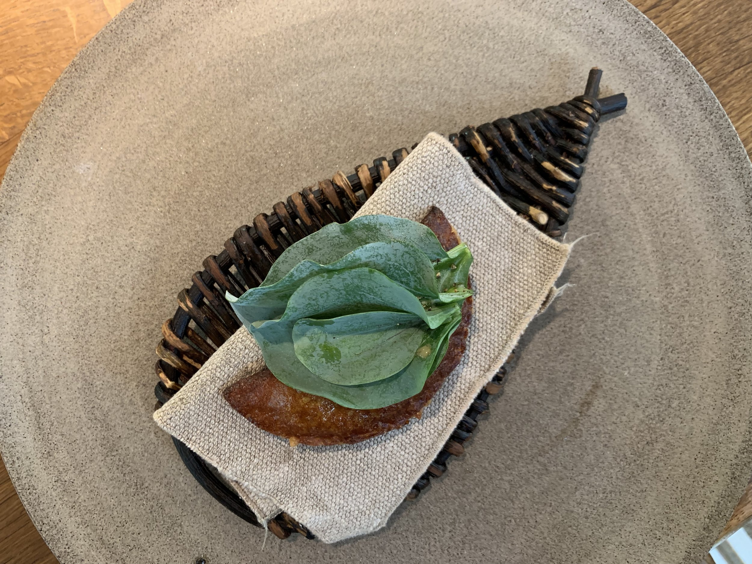 Salt Cod Pie - Here they made a cod pie out of milk skin, very similar to the caramelized milk and cheese dish we had during the Vegetable Season. This is served with oyster leaves on top. Why are they called oyster leaves? Because they actually have the flavor of oysters! So cool.