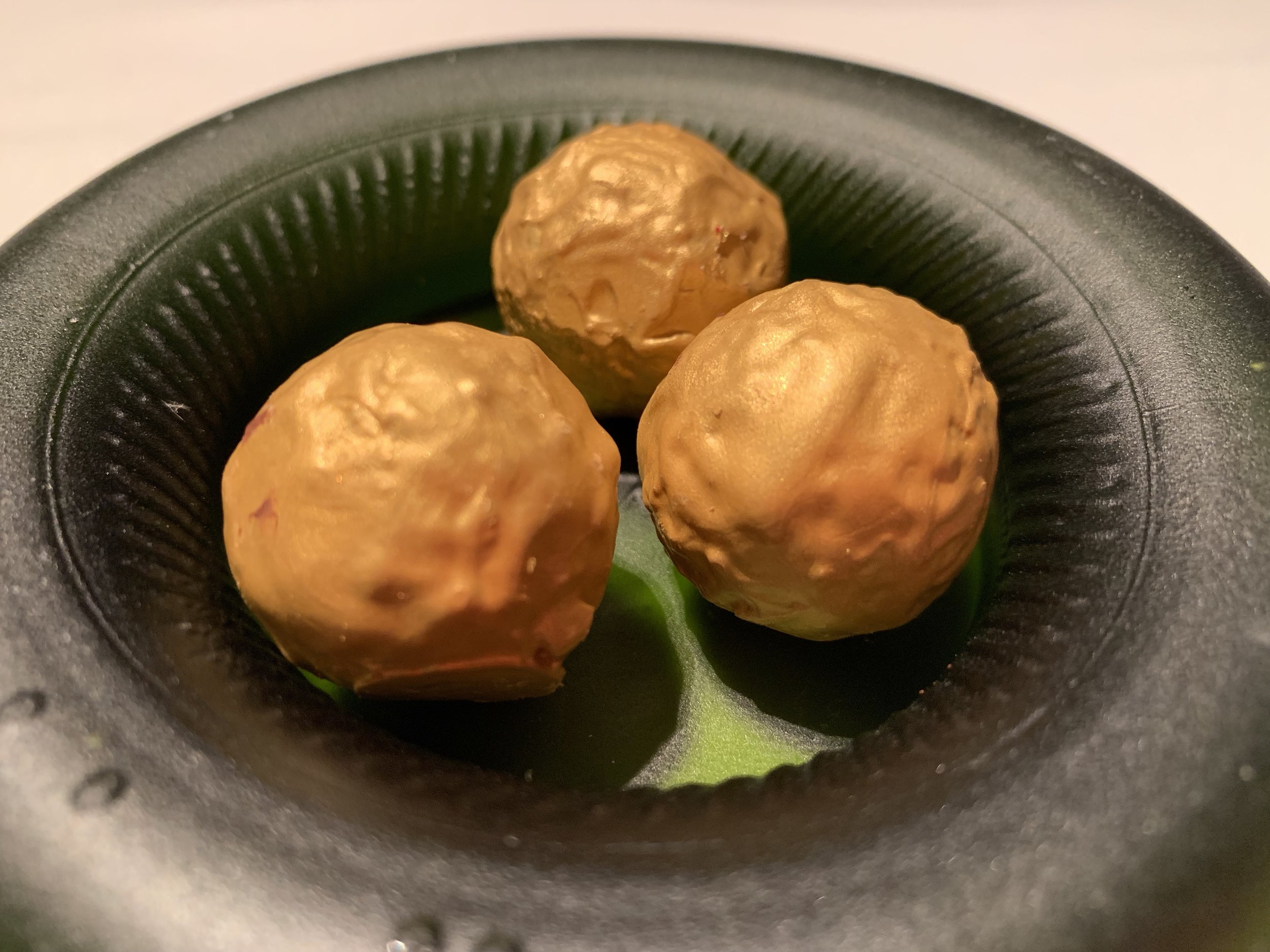 Golden balls that had pop rocks in them