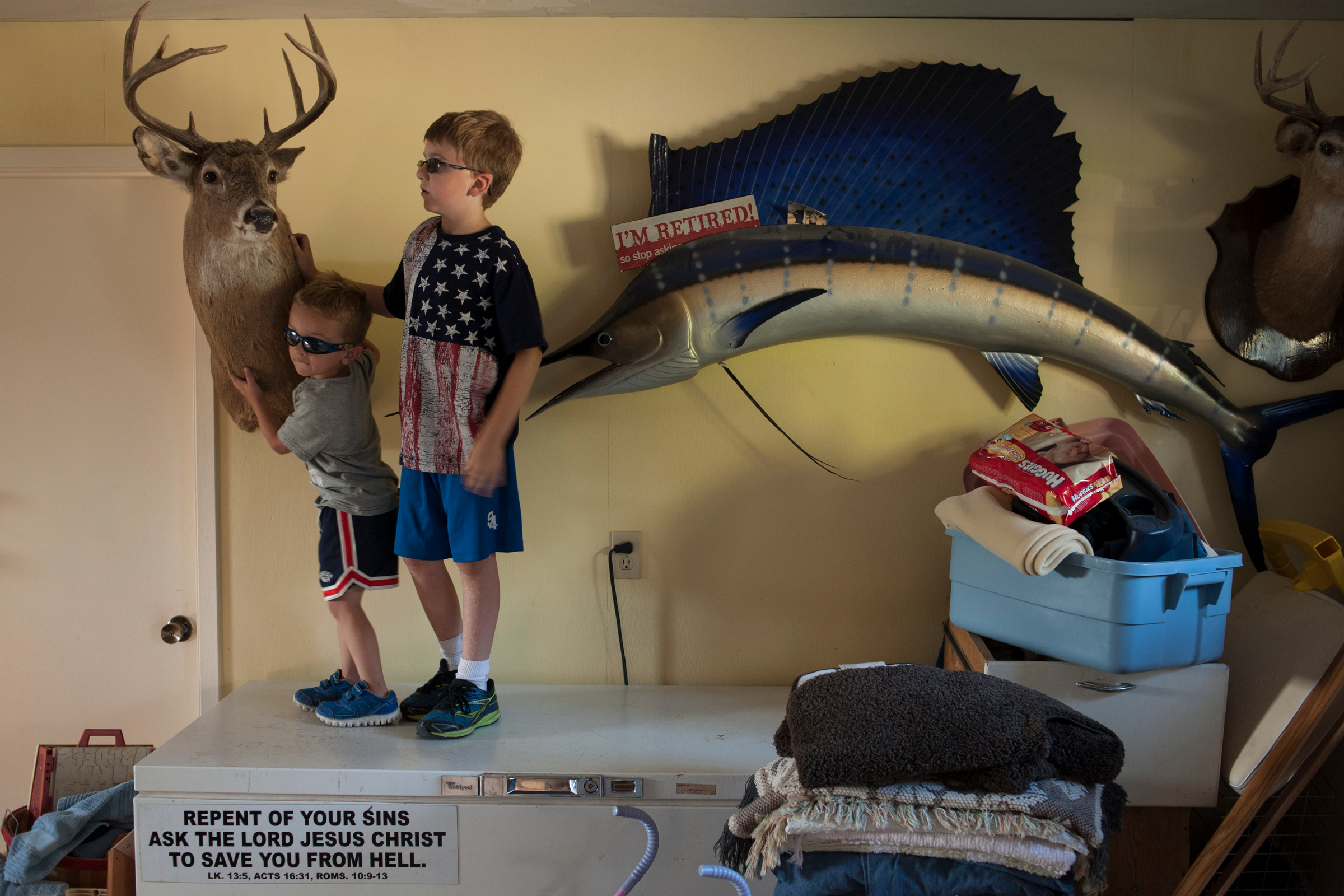 Andrew Weborg, left, plays with his cousin at Andrew's grandparents house. Jeff and Betty Weborg live in the former summer kitchen house that has belonged in the multi-generational fishing family for decades.