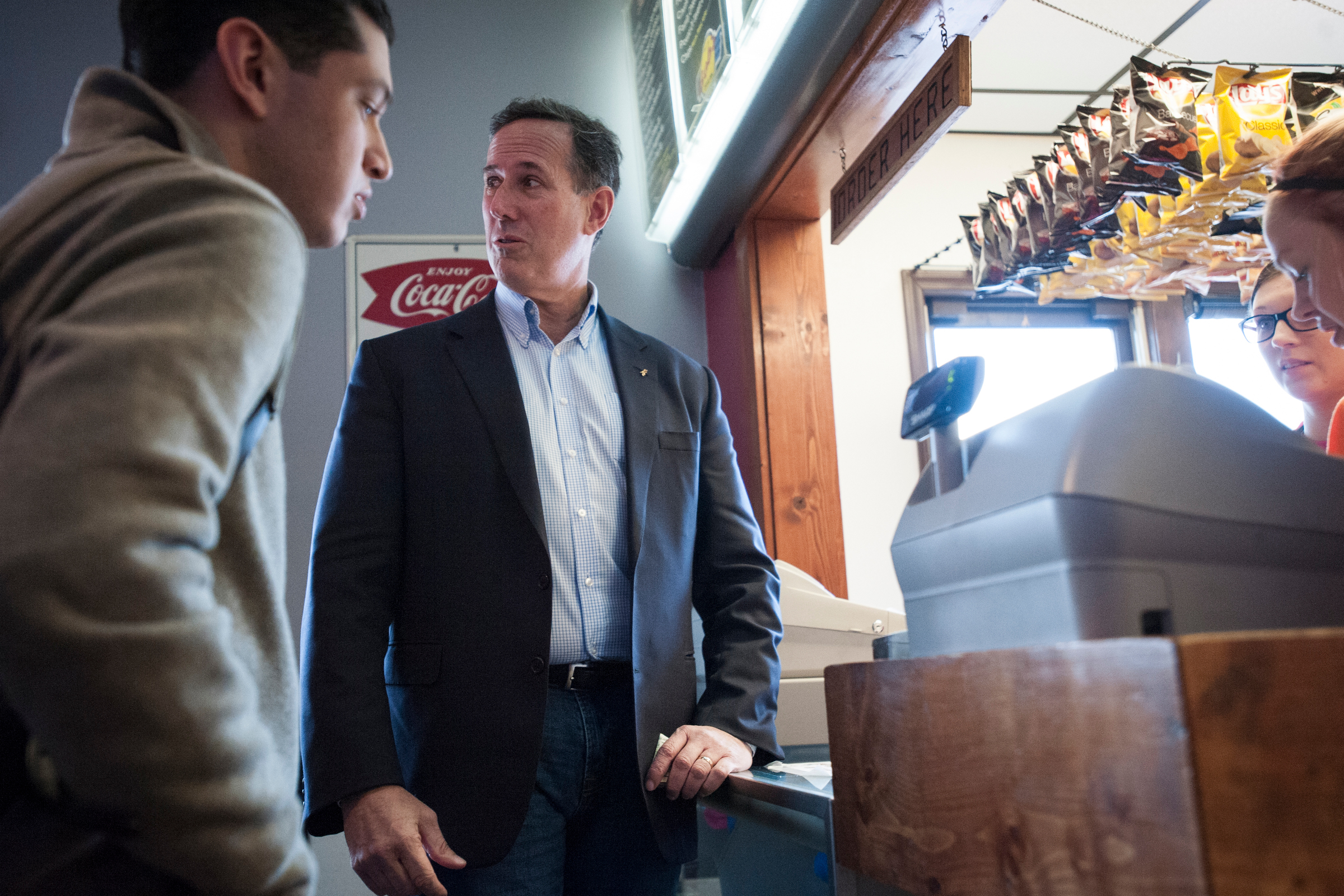 Republican presidential candidate Rick Santorum orders lunch for his staff at Bob's Drive Inn during a break between campaign stops in Le Mars, Iowa.