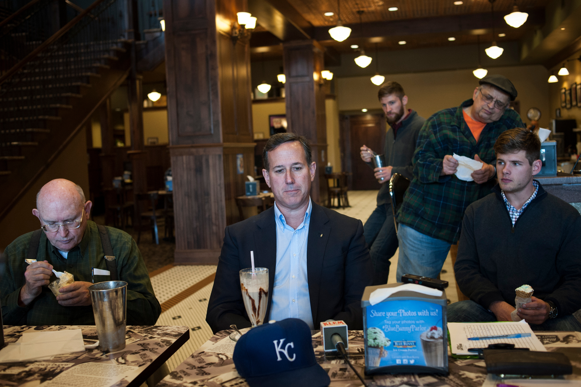 Republican presidential candidate Rick Santorum listens to a question at a town hall at the Blue Bunny Ice Cream Parlor in Le Mars, Iowa.