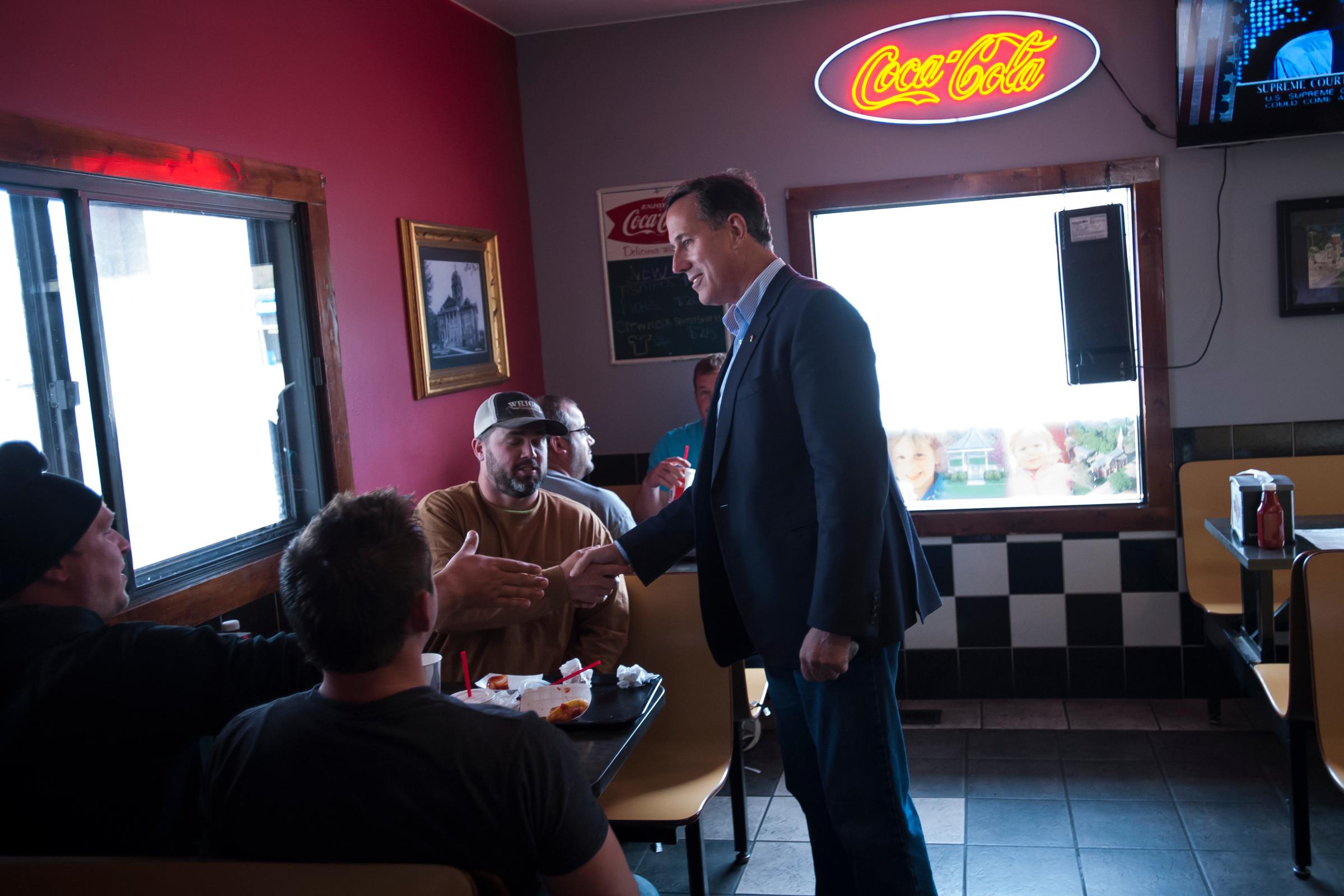 Republican presidential candidate Rick Santorum greets people having lunch at Bob's Drive Inn in Le Mars, Iowa.