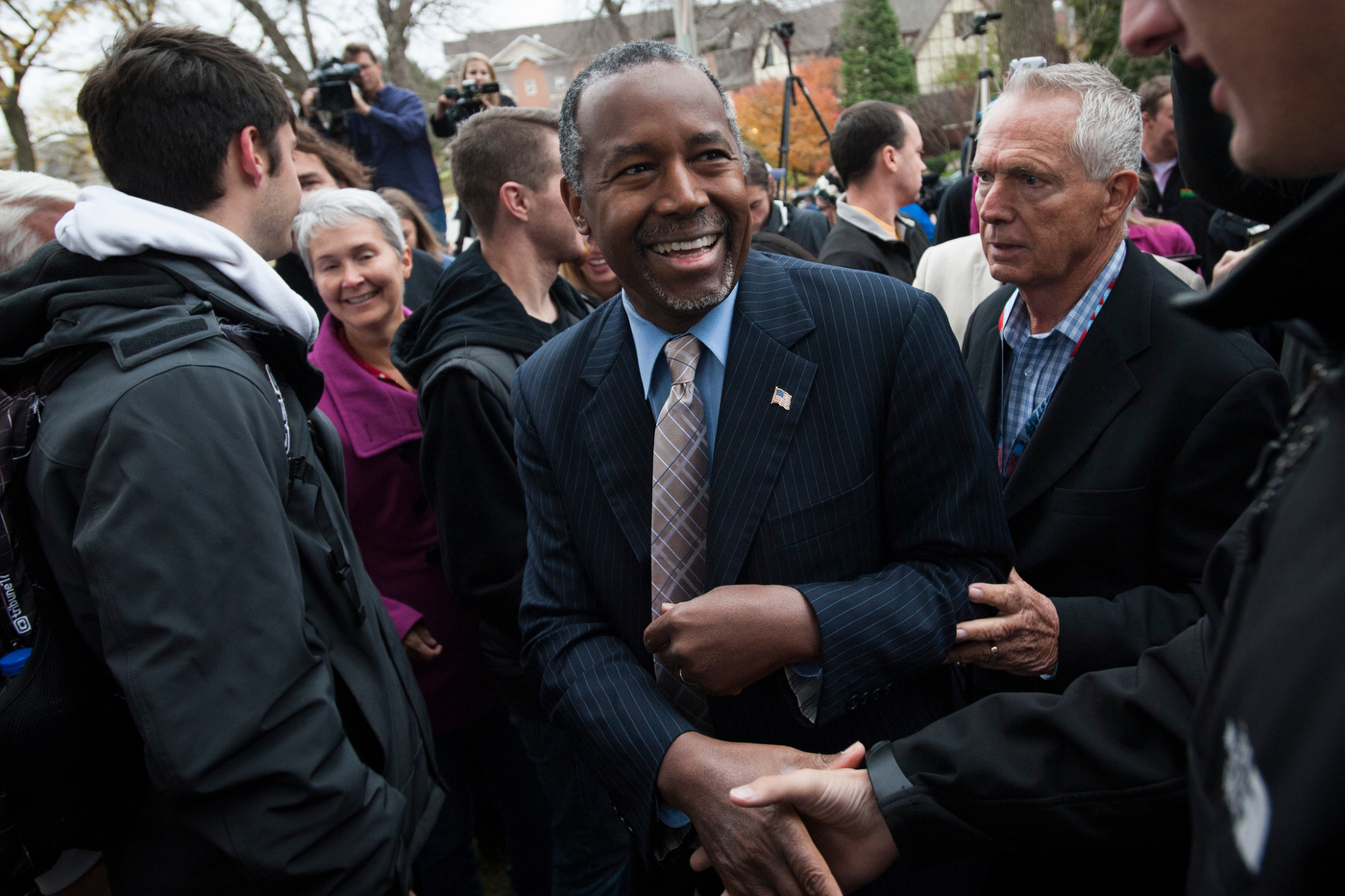 Republican presidential candidate Dr. Ben Carson greets supporters after a speech at the Alpha Gamma Roh fraternity at Iowa State University in Ames, Iowa.