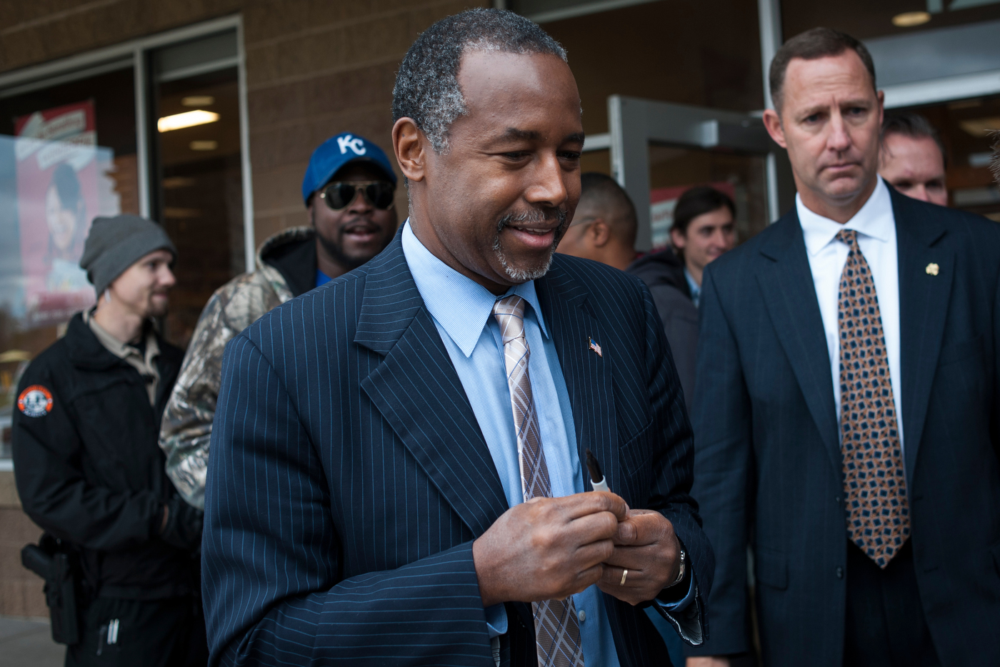 Republican presidential candidate Dr. Ben Carson leaves a book signing and campaign event in Ames, Iowa.
