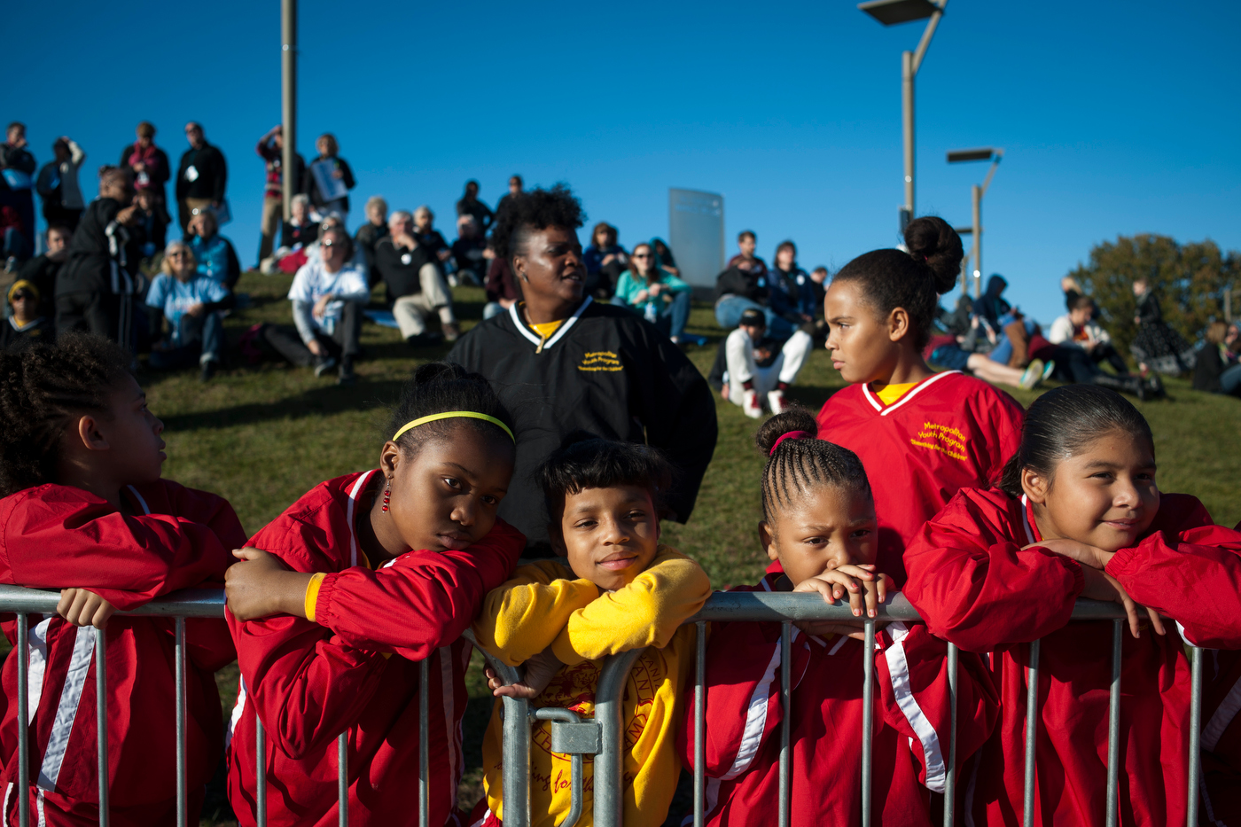 Members of the Quad Cities Metropolitan Youth Program listen as their drumline warms up the crowd ahead of a campaign rally and march for Sen. Bernie Sanders in Des Moines, IA.