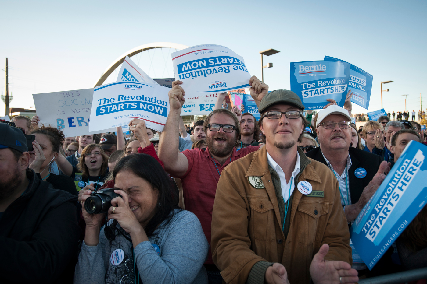 Supporters cheer as Democratic presidential candidate Sen. Bernie Sanders speaks at a campaign rally in Des Moines, IA.