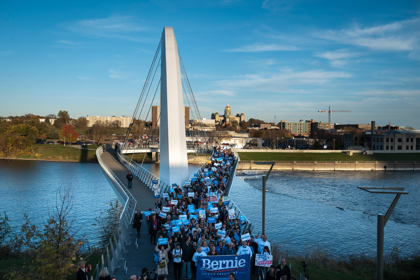 Democratic presidential candidate Sen. Bernie Sanders participates marches with supporters across the Iowa Women of Achievement Bridge in downtown Des Moines.