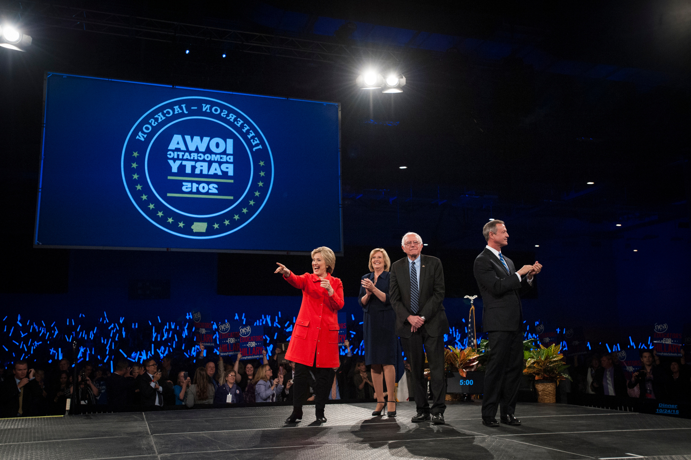 From left, Hillary Clinton, Iowa Democratic Chairwoman Dr. Andy McGuire, Bernie Sanders, and Martin O'Malley, greet the crowd at the Jefferson-Jackson Dinner in Des Moines, Iowa.