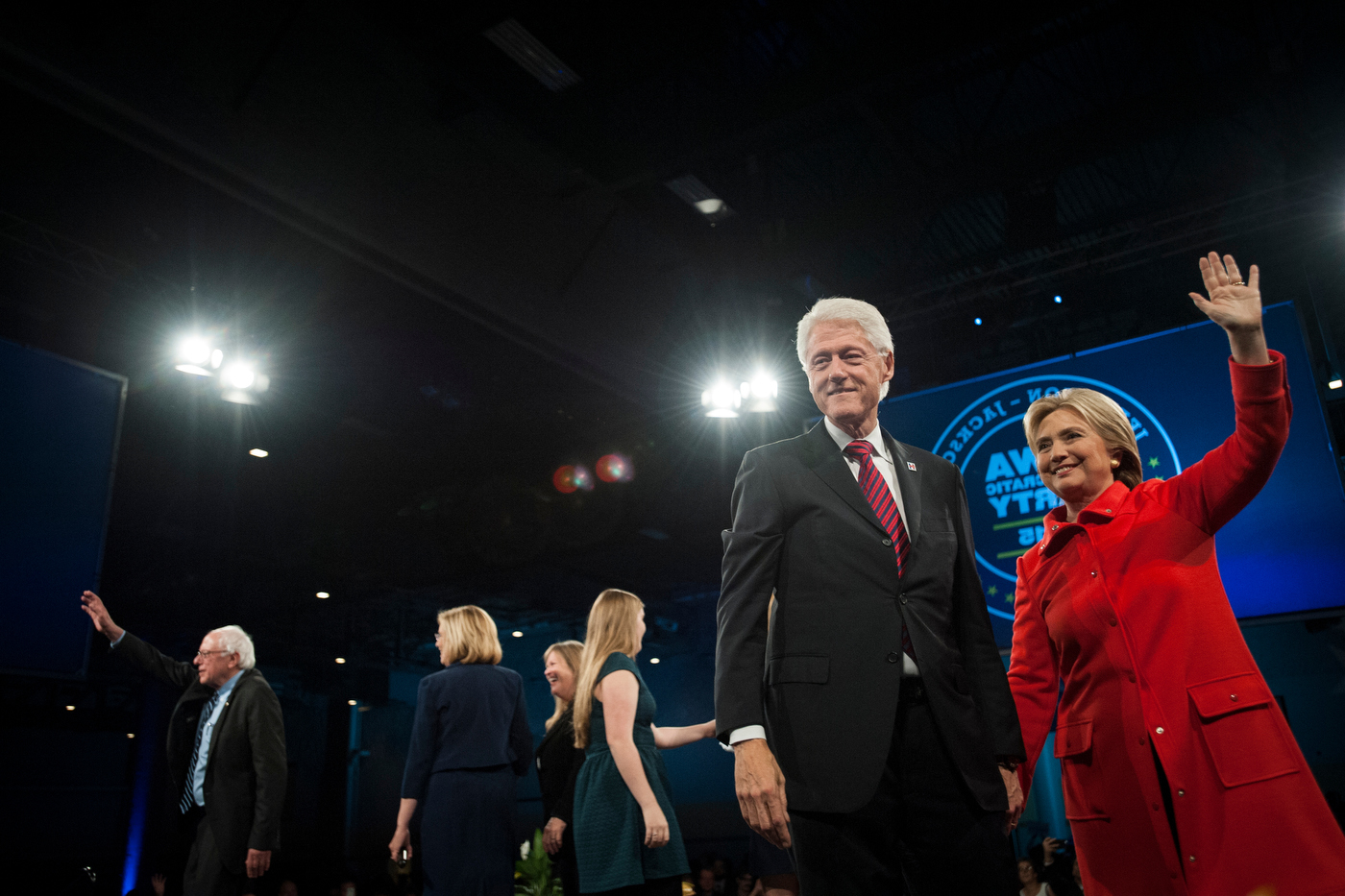 President Bill Clinton and Hillary Clinton, right, greet the crowd and media as Bernie Sanders, left, waves towards his supporters at the end of 2015 Iowa Jefferson-Jackson Dinner in Des Moines.