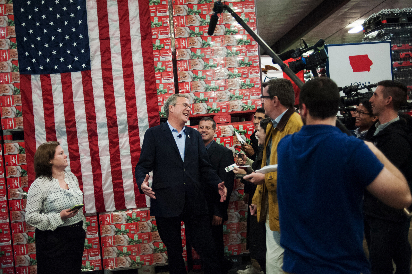 U.S. Republican presidential candidate Jeb Bush speaks with the media after a town hall at the Coca-Cola bottling plant in Atlantic, IA November 11, 2015.