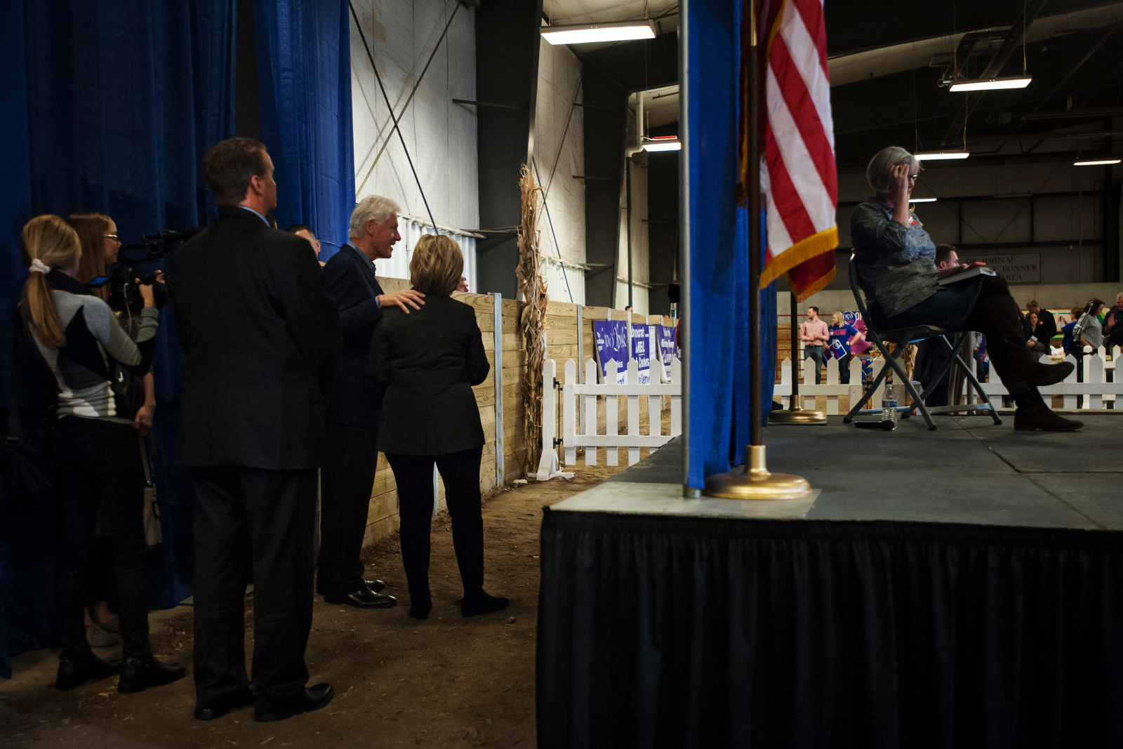 Democratic U.S. presidential candidate Hillary Clinton and Former U.S. President Bill Clinton speak behind the stage at the Central Iowa Democrats Fall Barbecue in Ames, Iowa November 15, 2015.
