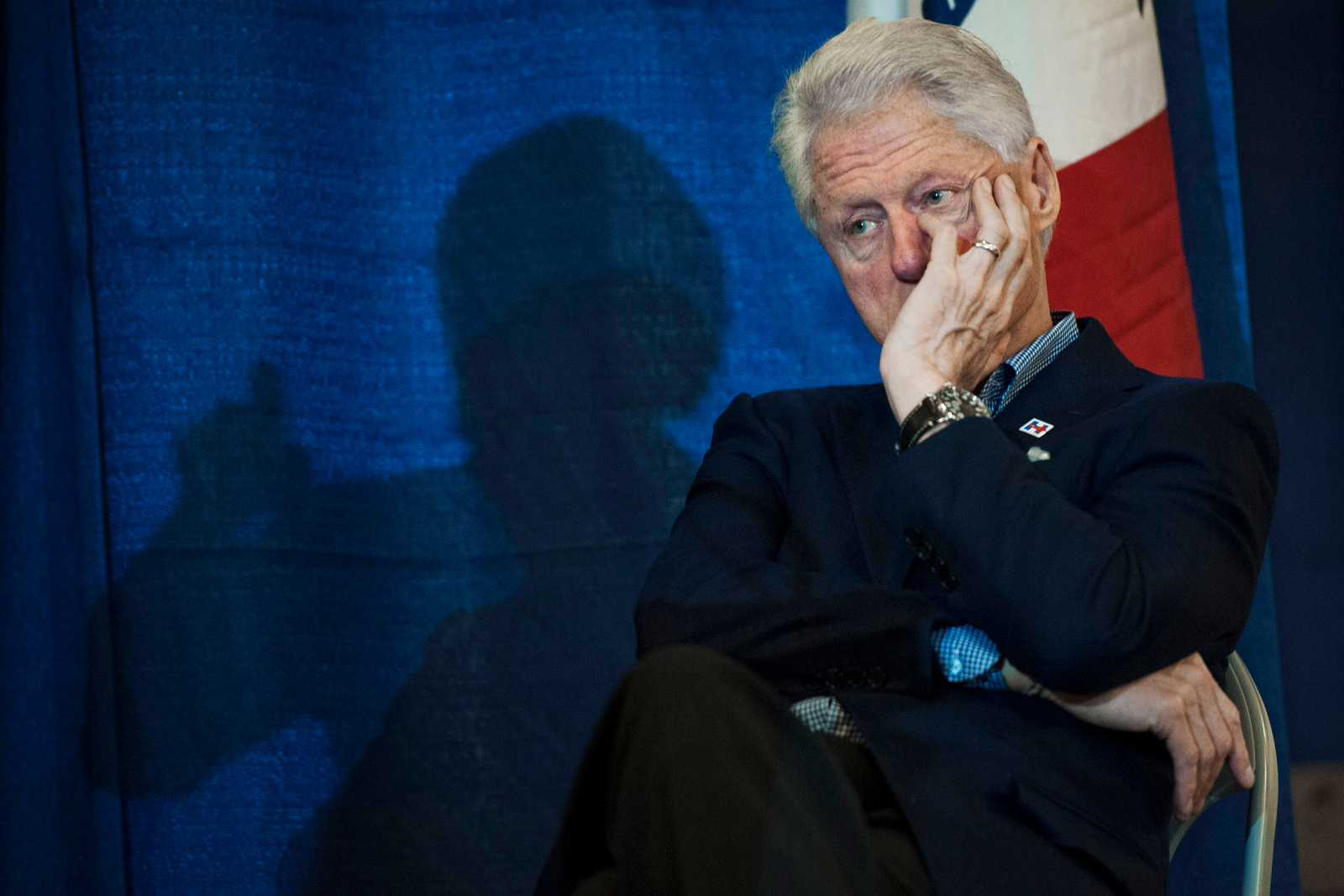 Former U.S. President Bill Clinton watches as Democratic U.S. presidential candidate Hillary Clinton speaks at the Central Iowa Democrats Fall Barbecue in Ames, Iowa November 15, 2015.